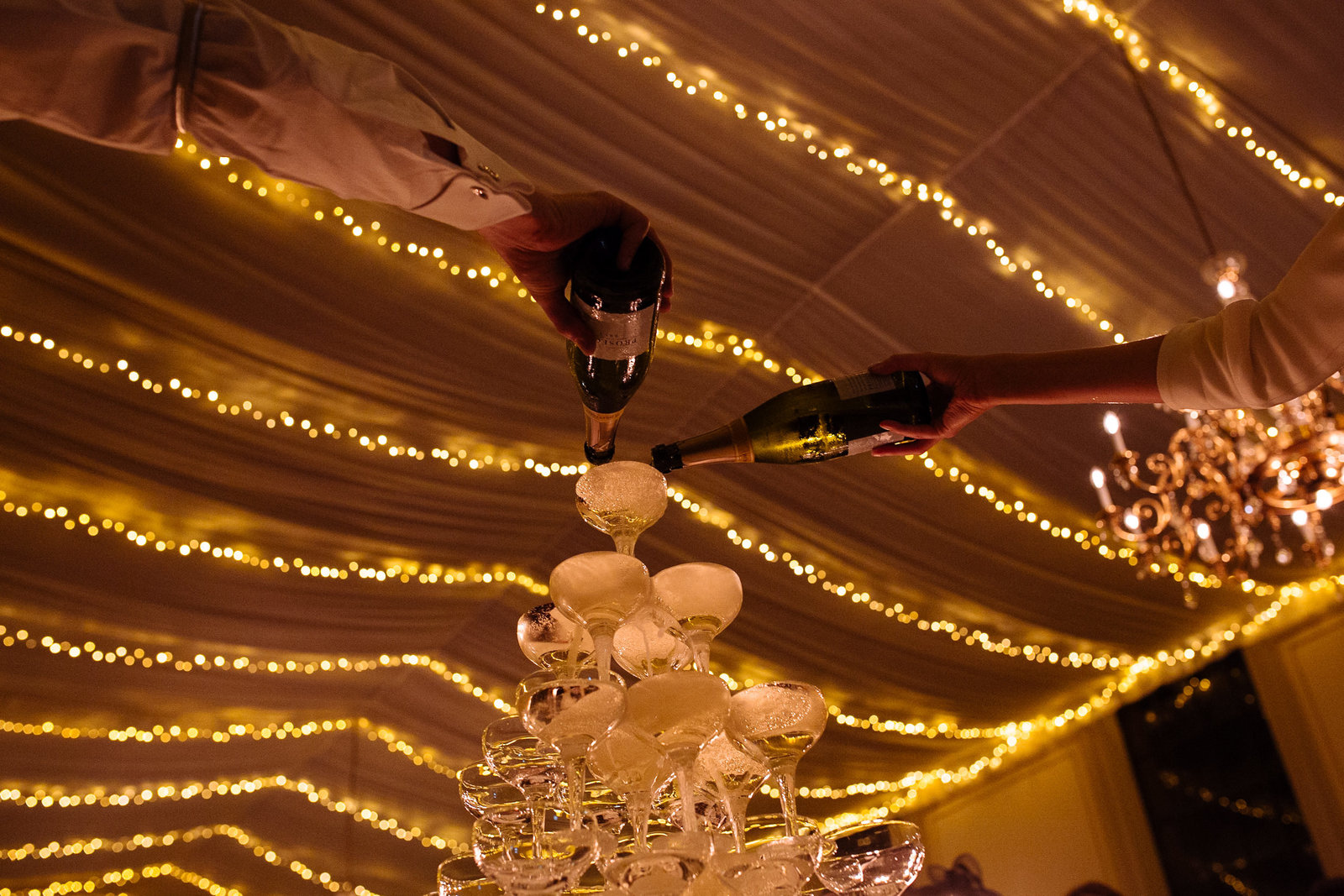 Champagne Tower at Rise Hall. Documentary wedding photographer