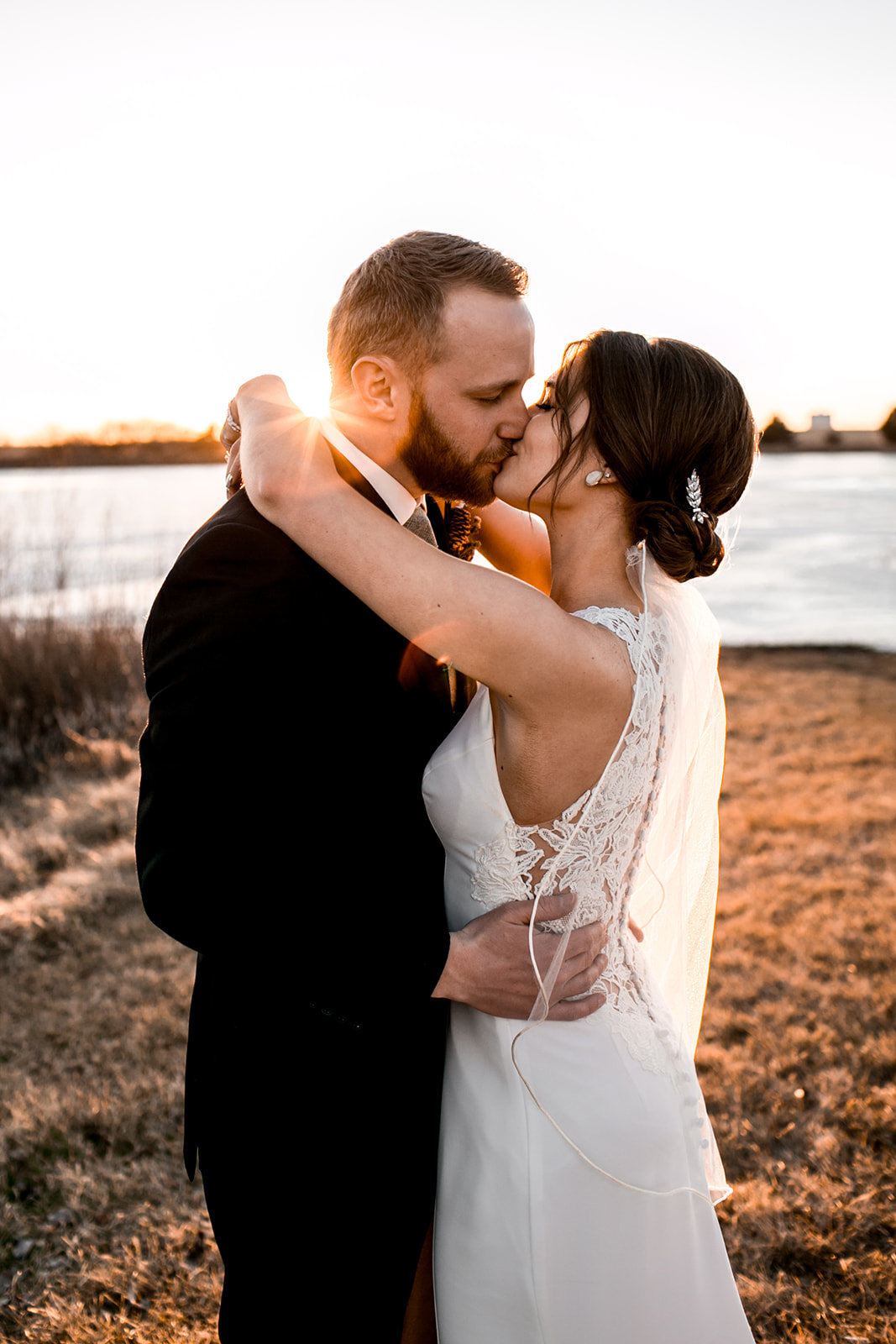 Des Moines Iowa Wedding couple kissing at sunset.