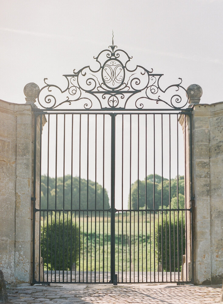 Large iron gate leading to parkland