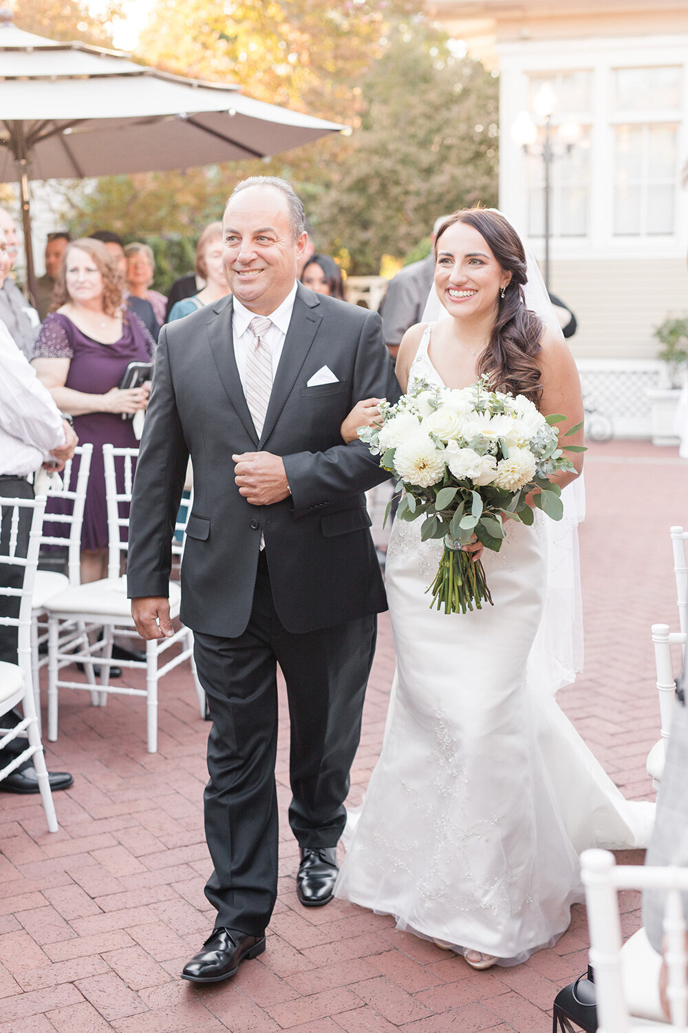 A father walks his daughter down the aisle at the vizcaya sacramento  by Adrienne and Dani Photography