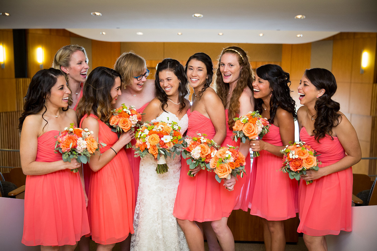 getting ready laughing with bridesmaids