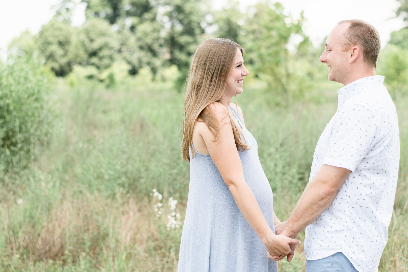Charlotte Maternity photographer shot of couple in field outside of uptown