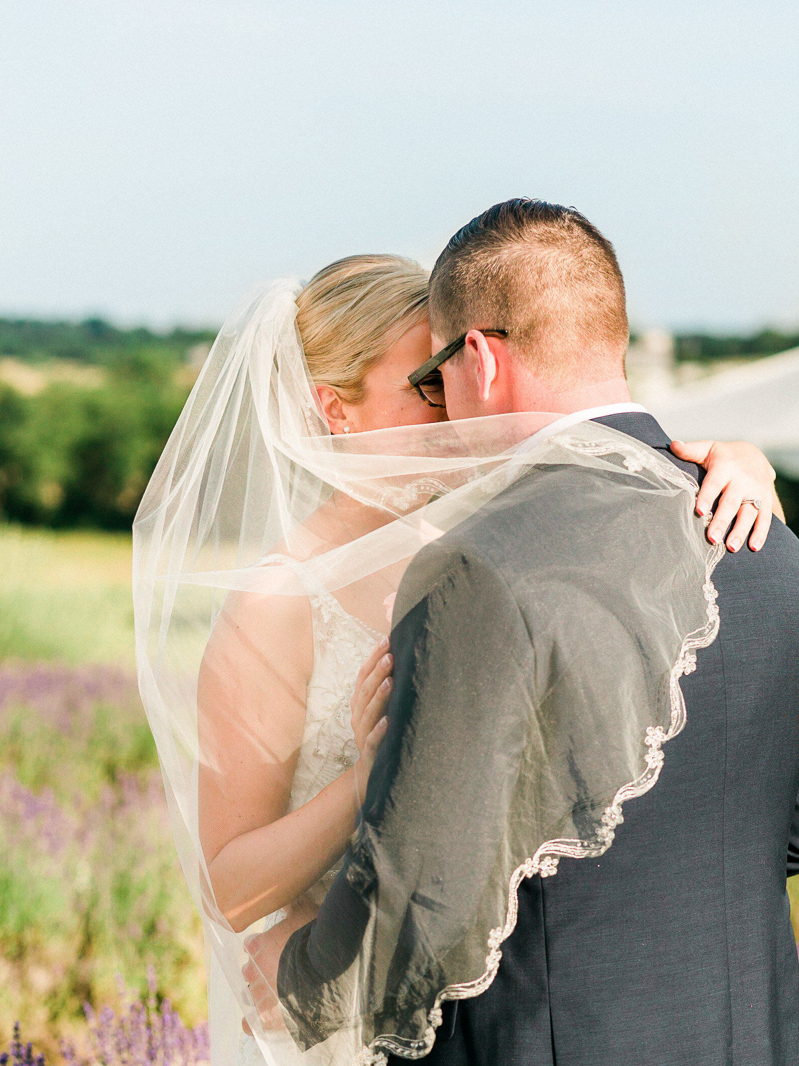 Bride in beaded gown and groom stand in a lavender field  Springfield Manor