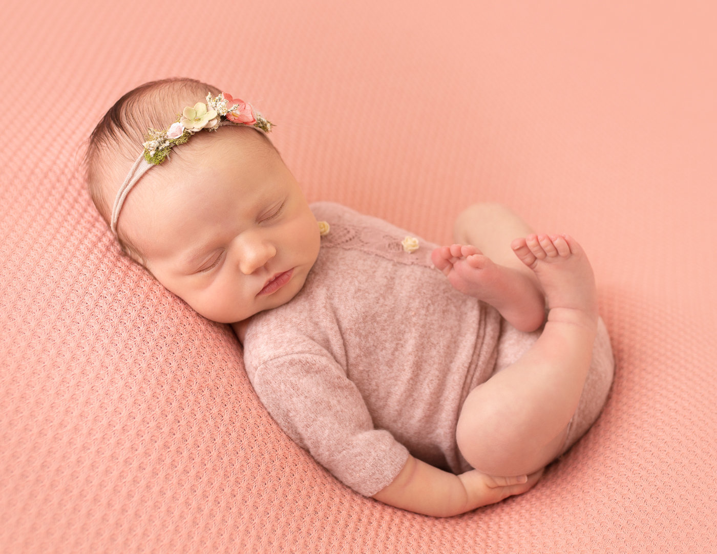 Newborn baby girl posed in our Rochester,  Ny studio.