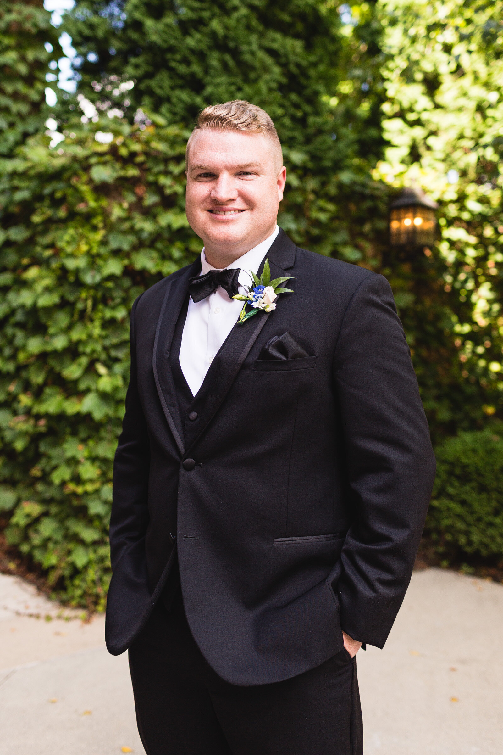 groom posing for portrait for summer wedding corazon ohio