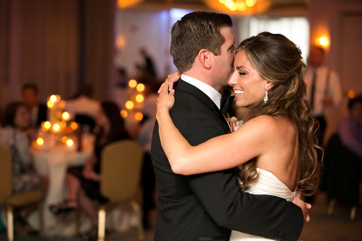 night shot at loews coronado bride and groom first dance