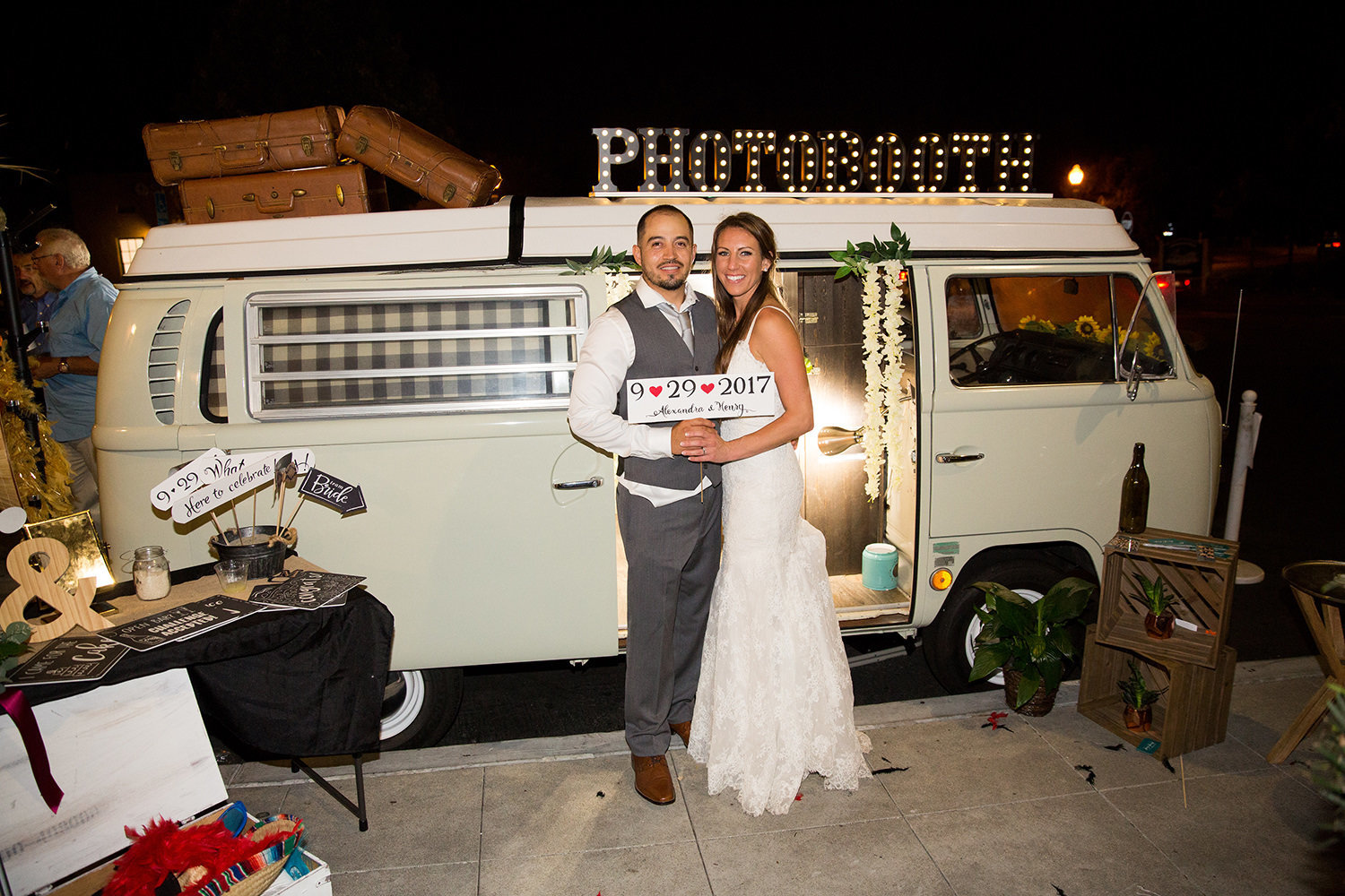 stunning night image with bride and groom at brick with vintage vw van