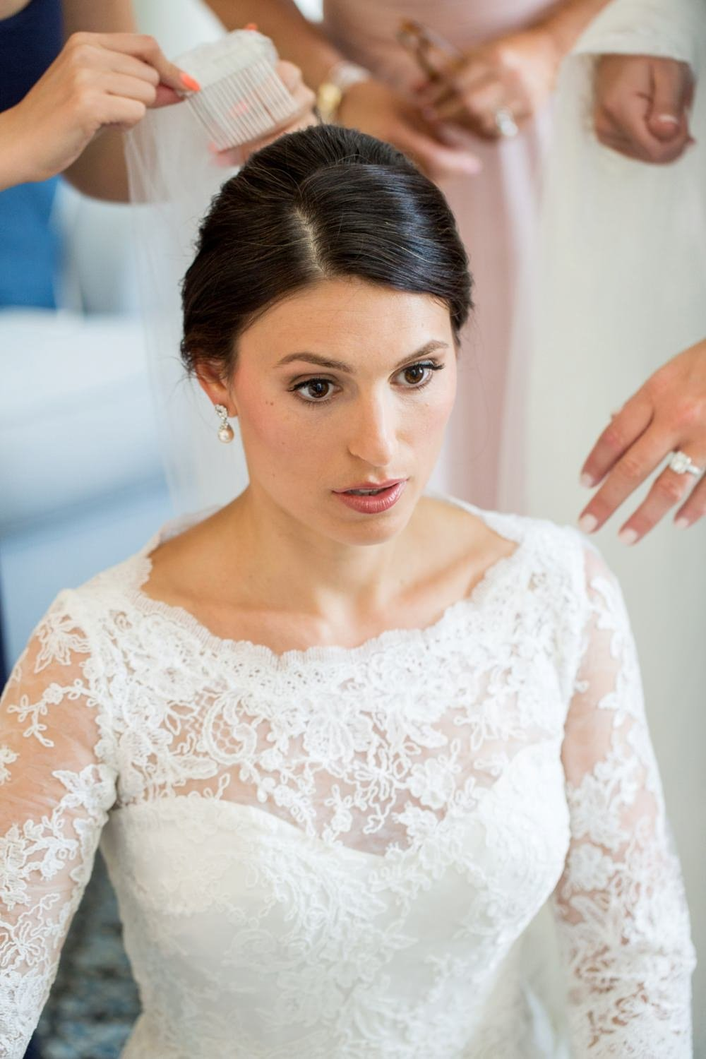 Classic bride getting ready for wedding at Eisenhower House in Newport, RI
