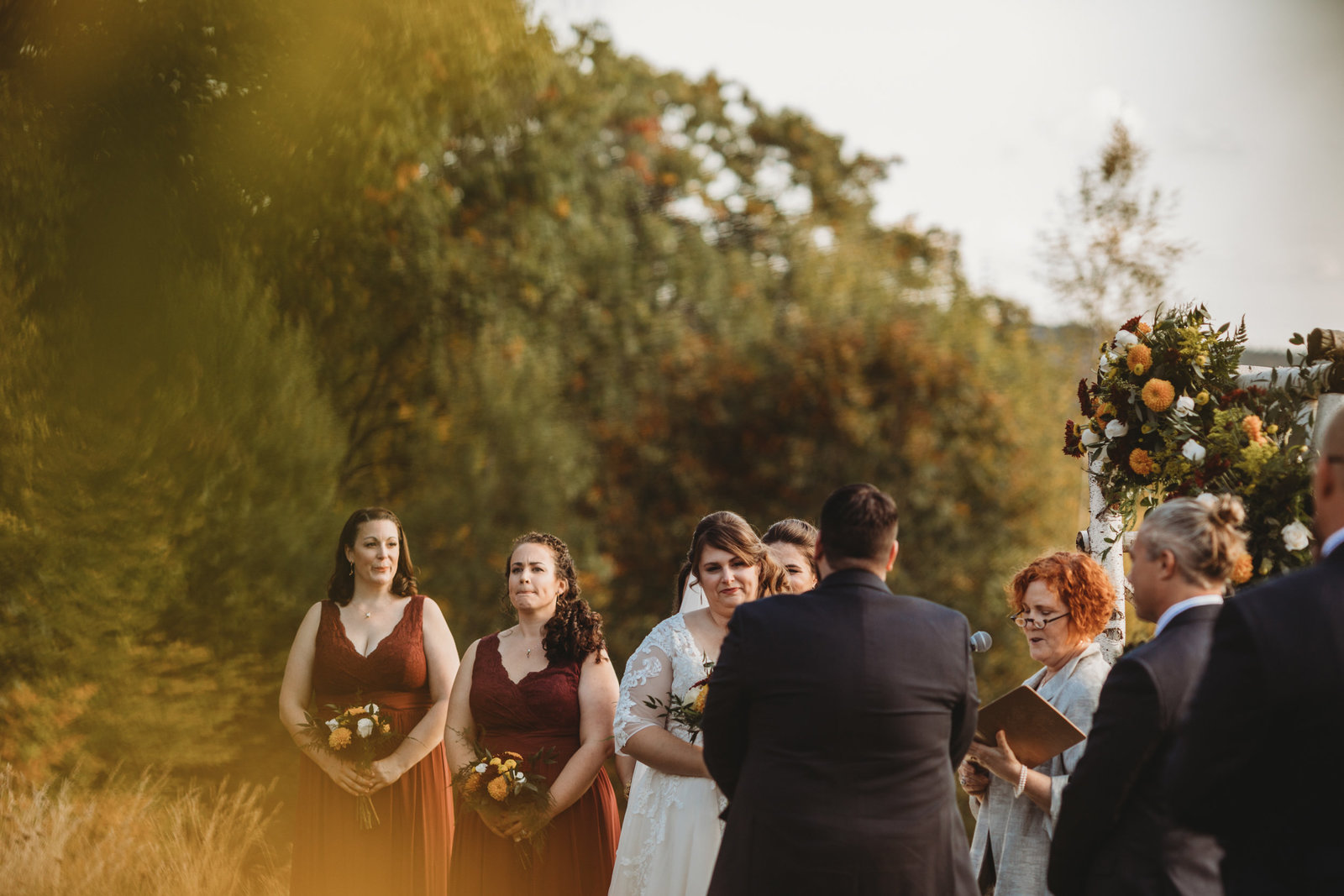 bride and groom exchange vows during outdoor fall ceremony in massachusetts