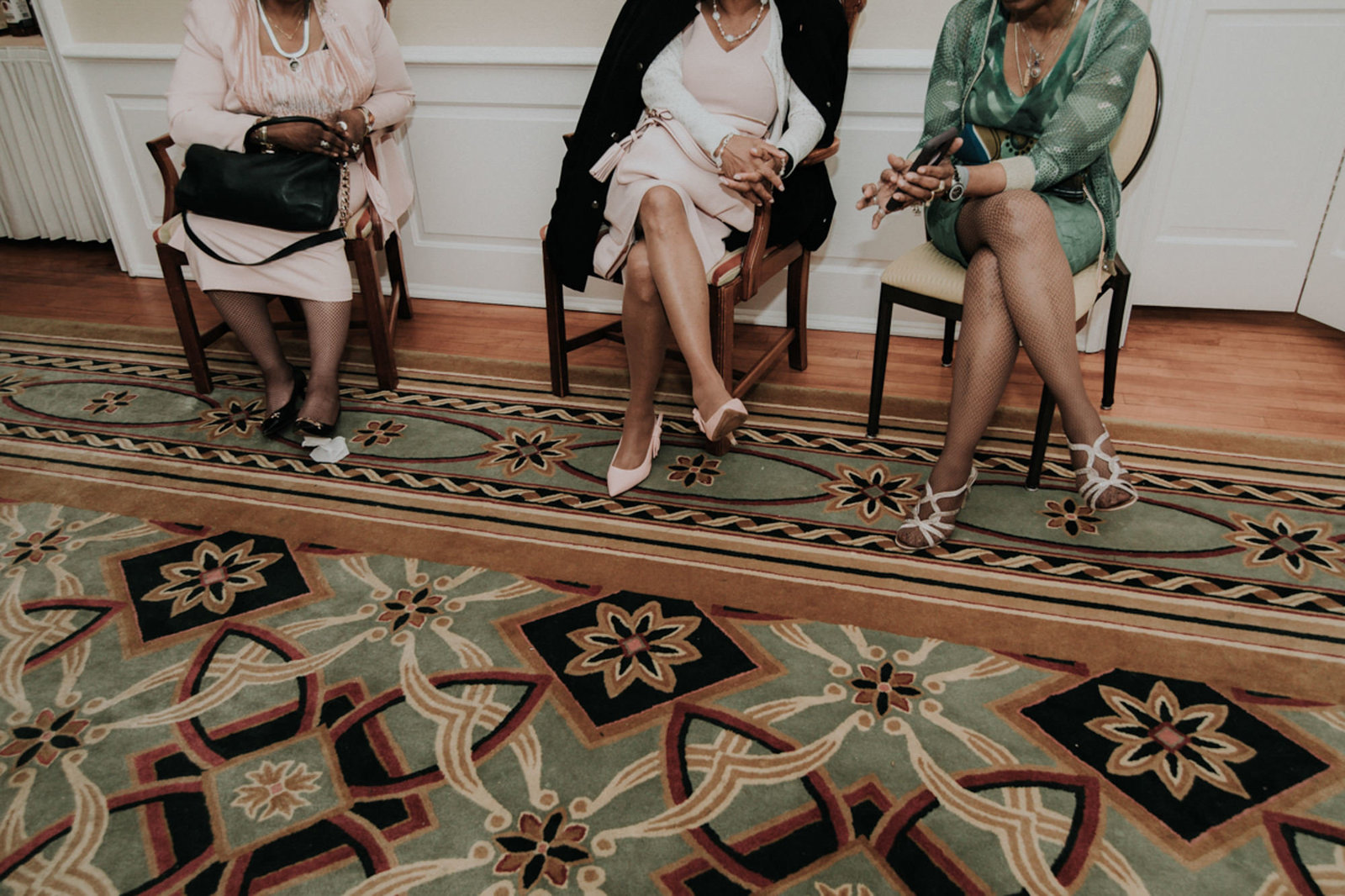 older women sitting waiting to go home at a wedding reception