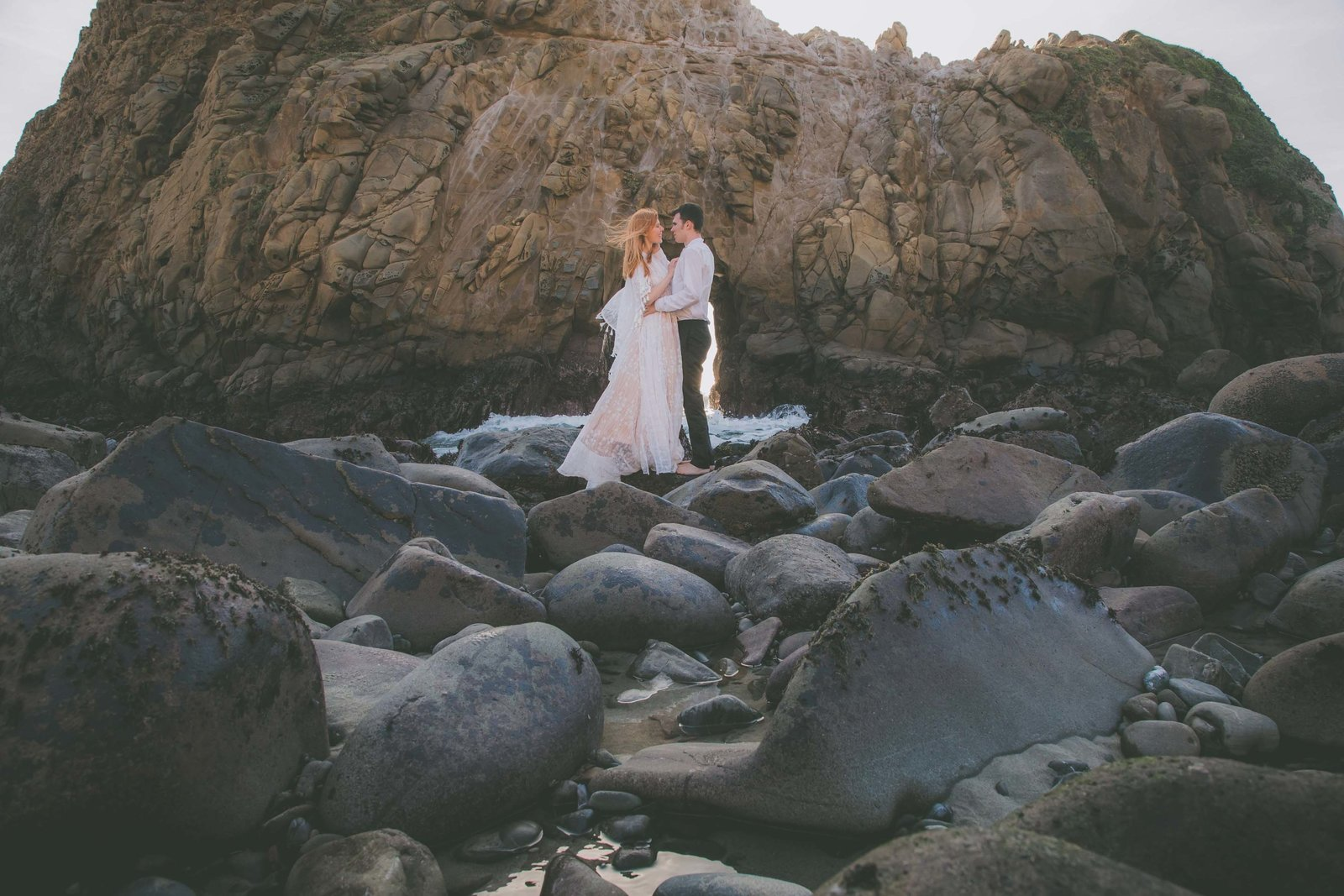Pfeiffer beach makes a gorgeous background for newlywed photos.