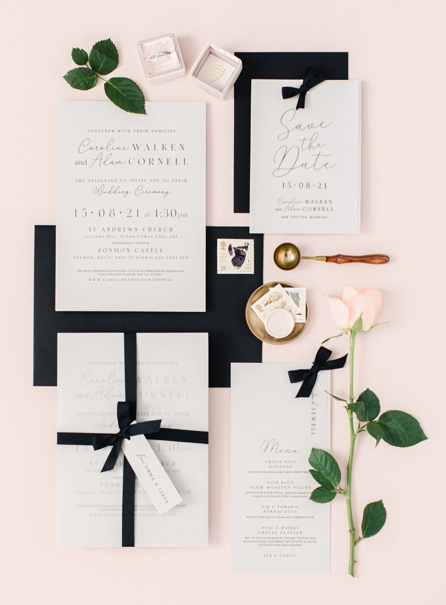 Wedding invites laying on heirloom bindery linen styling board