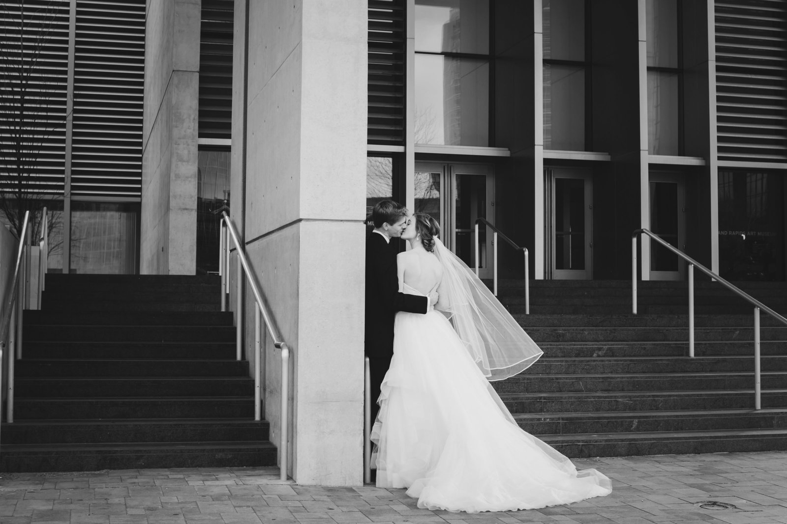 Bride and Groom Kissing on the steps of Grand Rapids Michigan art museum