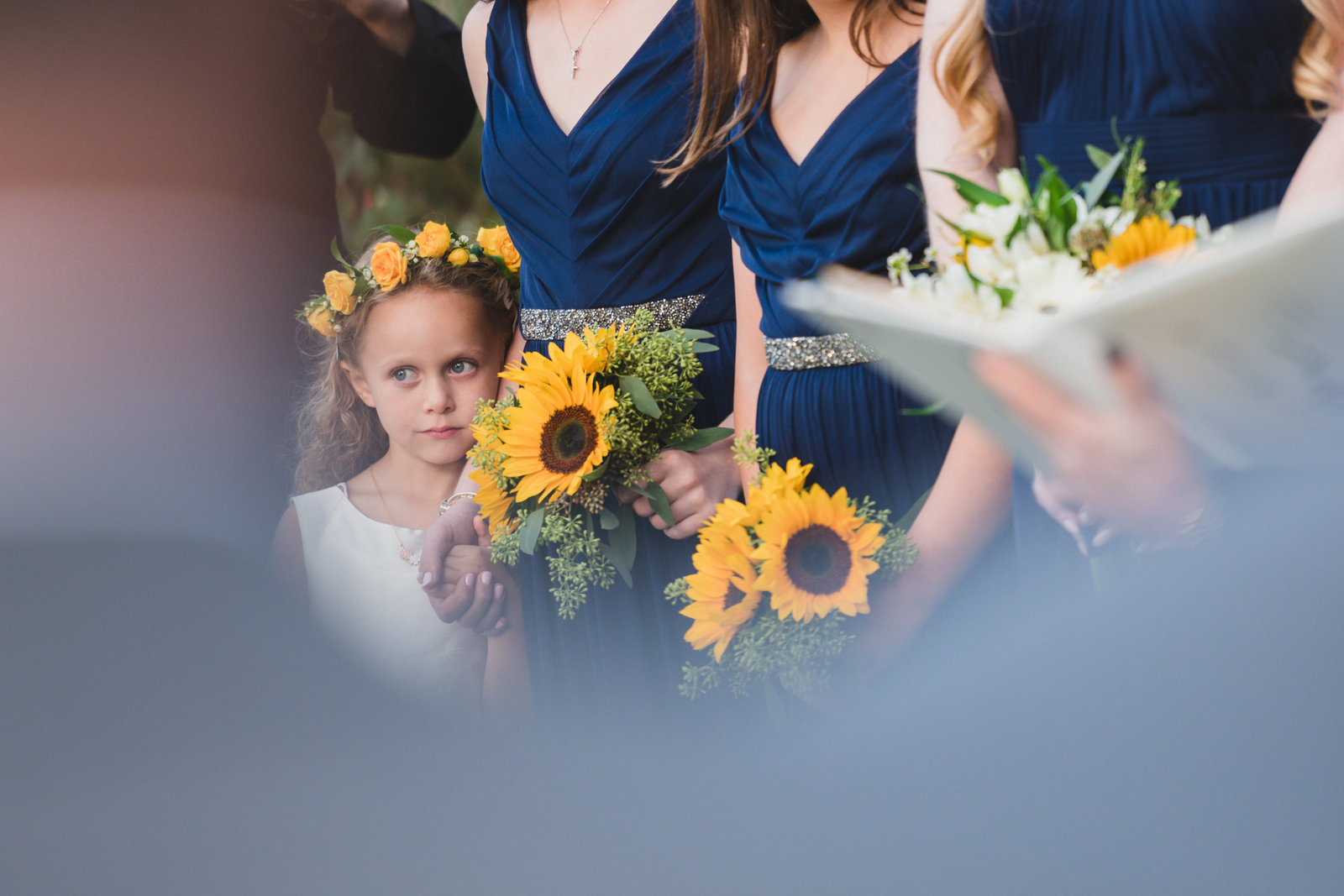 photo of flower girl and bouquets from wedding at Three Village Inn