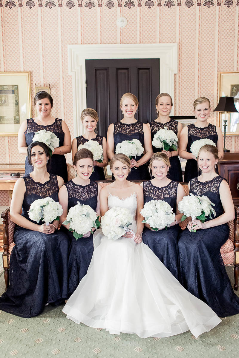 Bride and bridesmaids pose in parlor, John Rutledge House Inn, Charleston, South Carolina