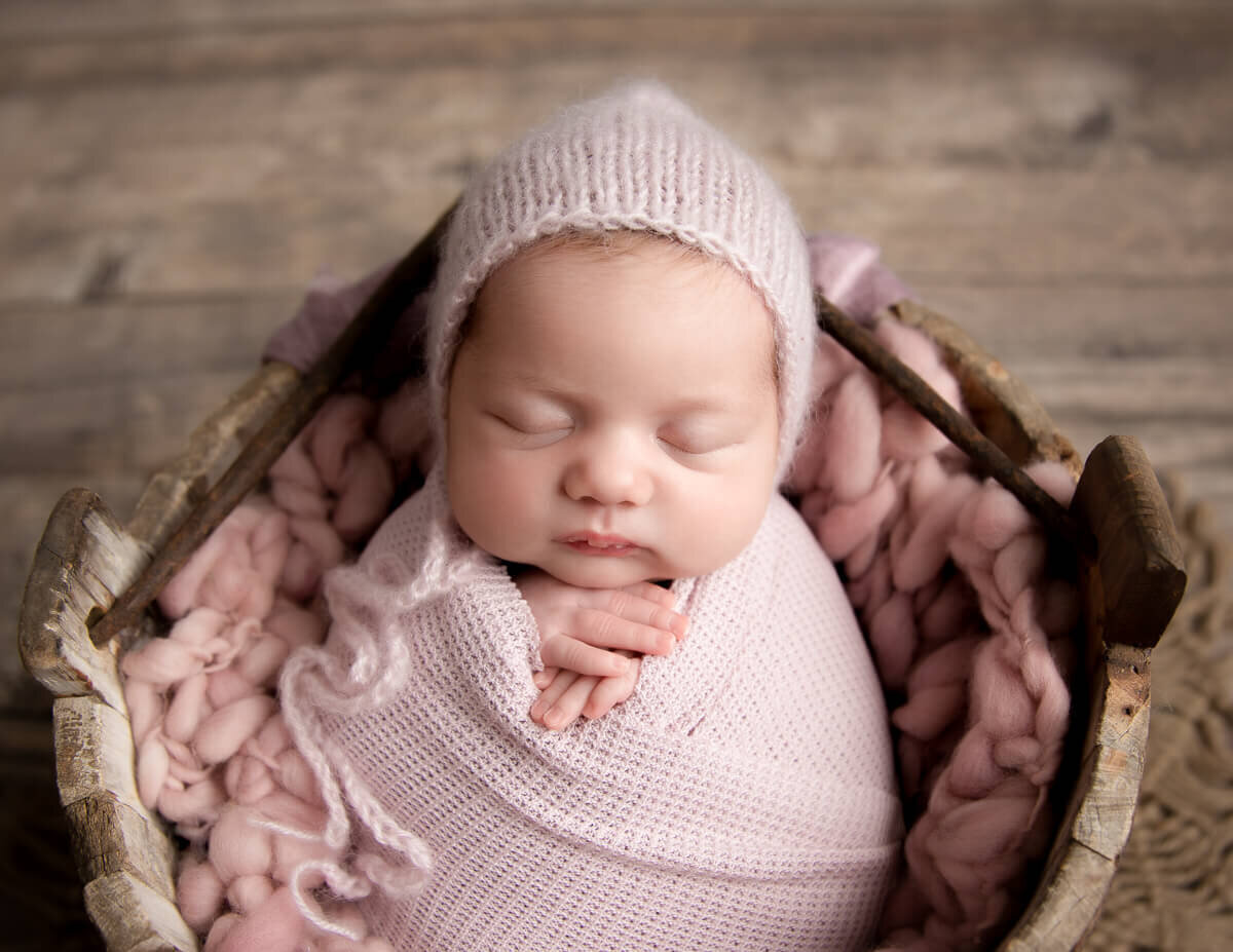 Beautiful baby girl posed at our Rochester, NY studio.