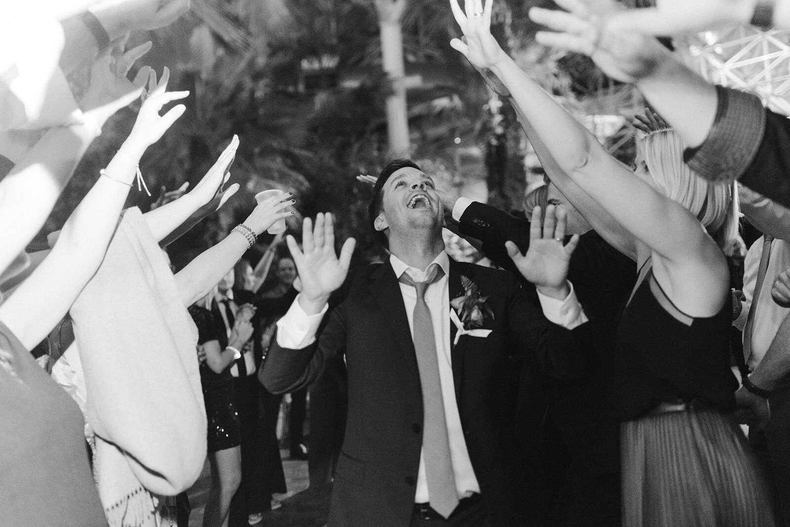 Groom dances with guests at his wedding reception
