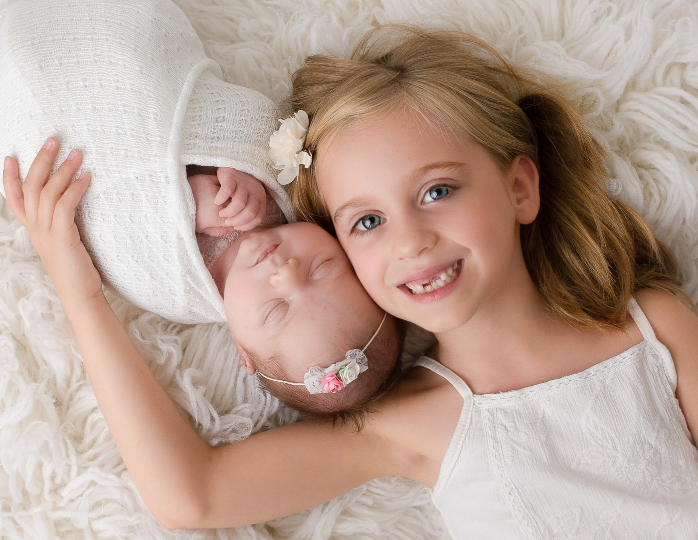 Sisters posed at our newborn studio in Rochester, NY.