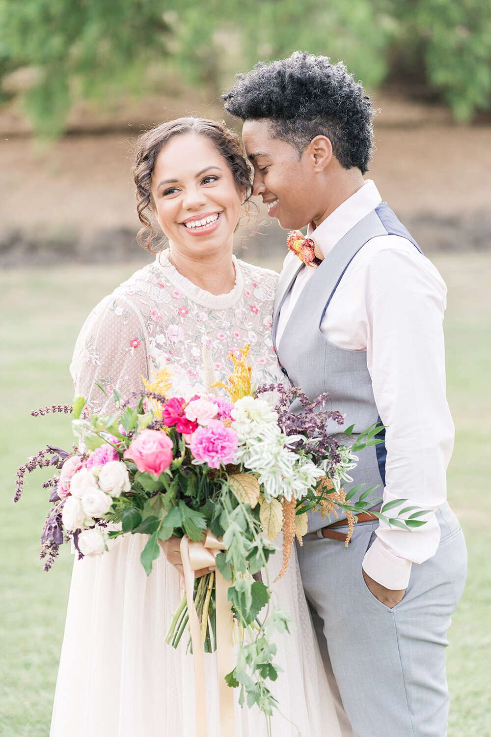 An lgbtq couple poses for portraits at the private estate micro wedding by Adrienne and Dani Photography
