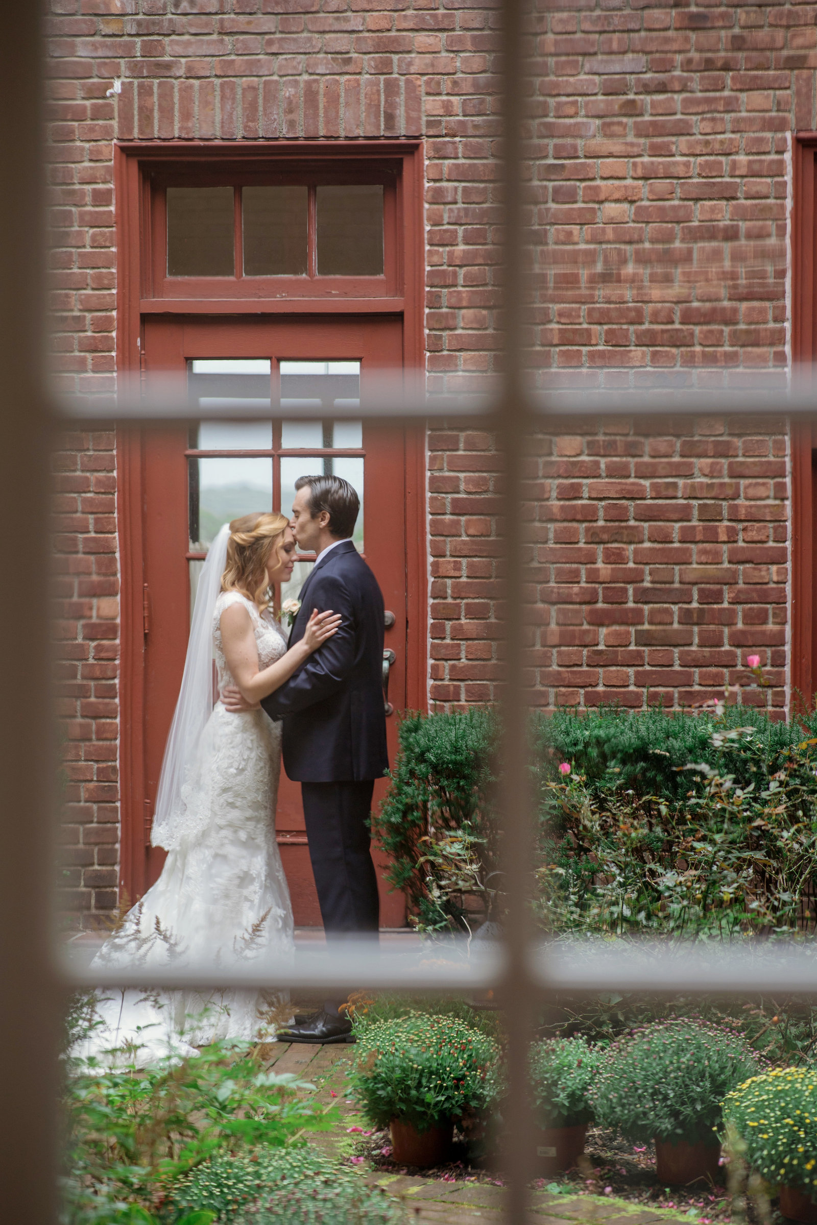 bride getting kiss on forehead photo at Coindre Hall