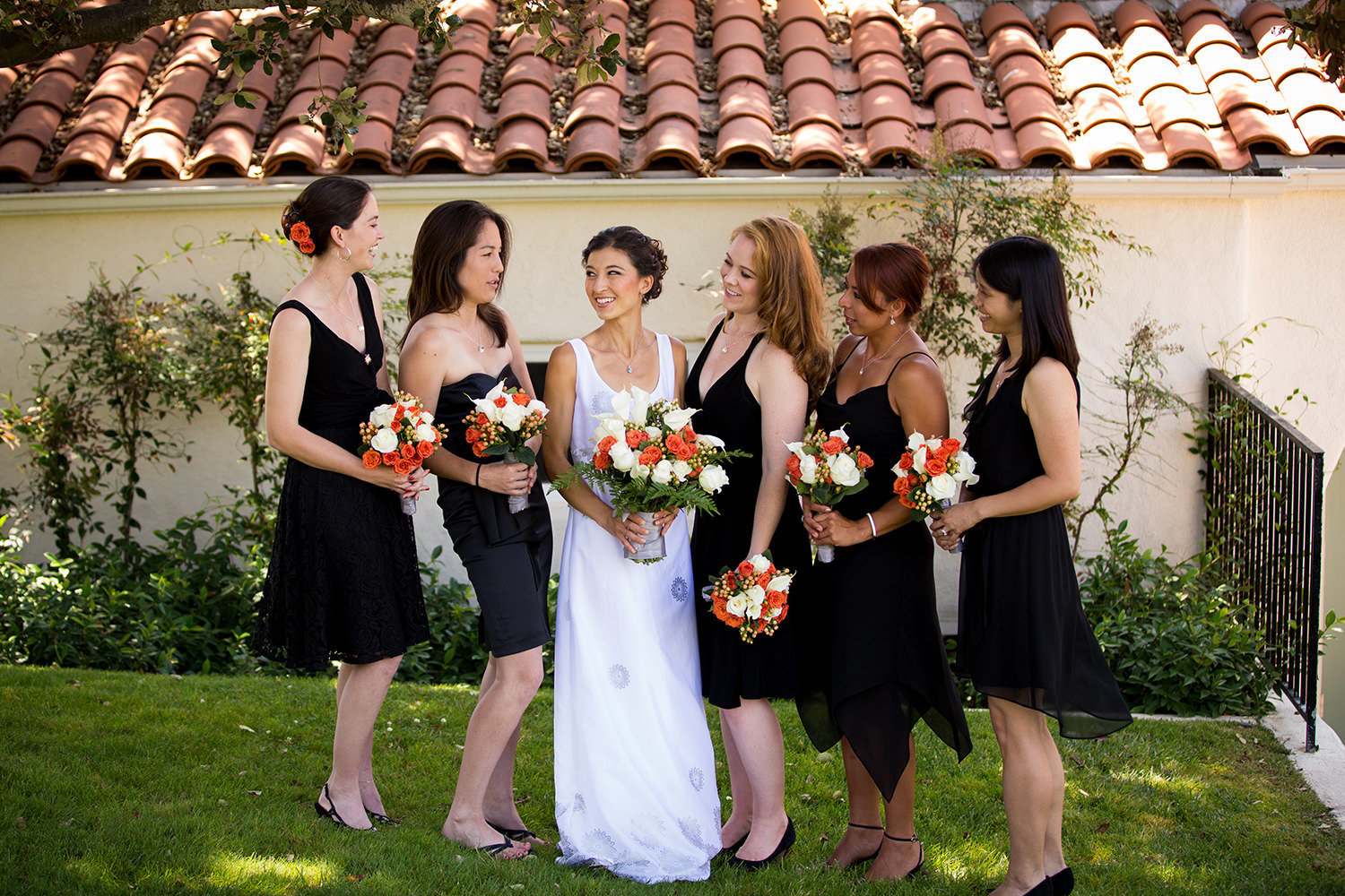 bride and bridesmaids in black dresses