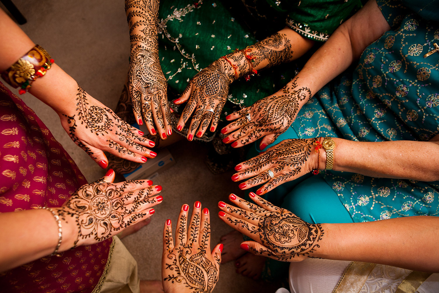 Detail of bride and bridesmaids henna before a hindu wedding ceremony