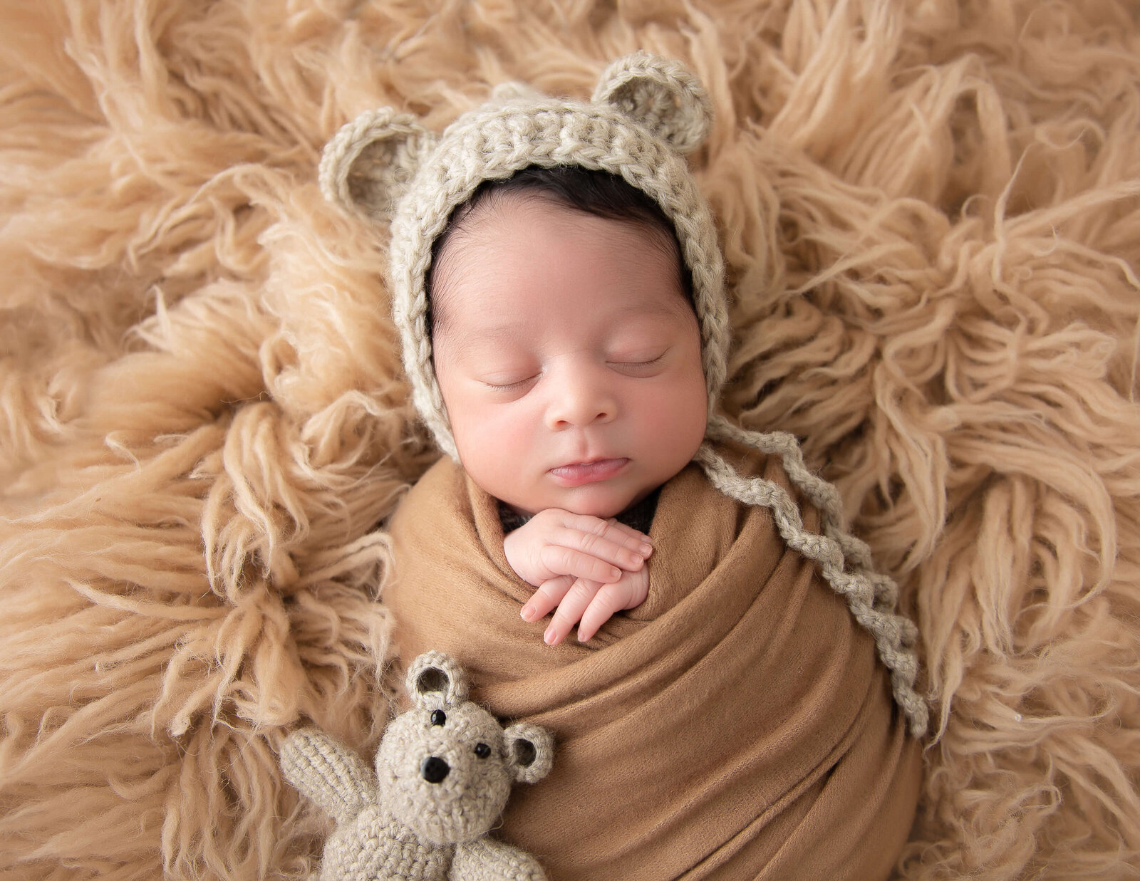 Newborn boy posed at our in-home Rochester, NY studio.