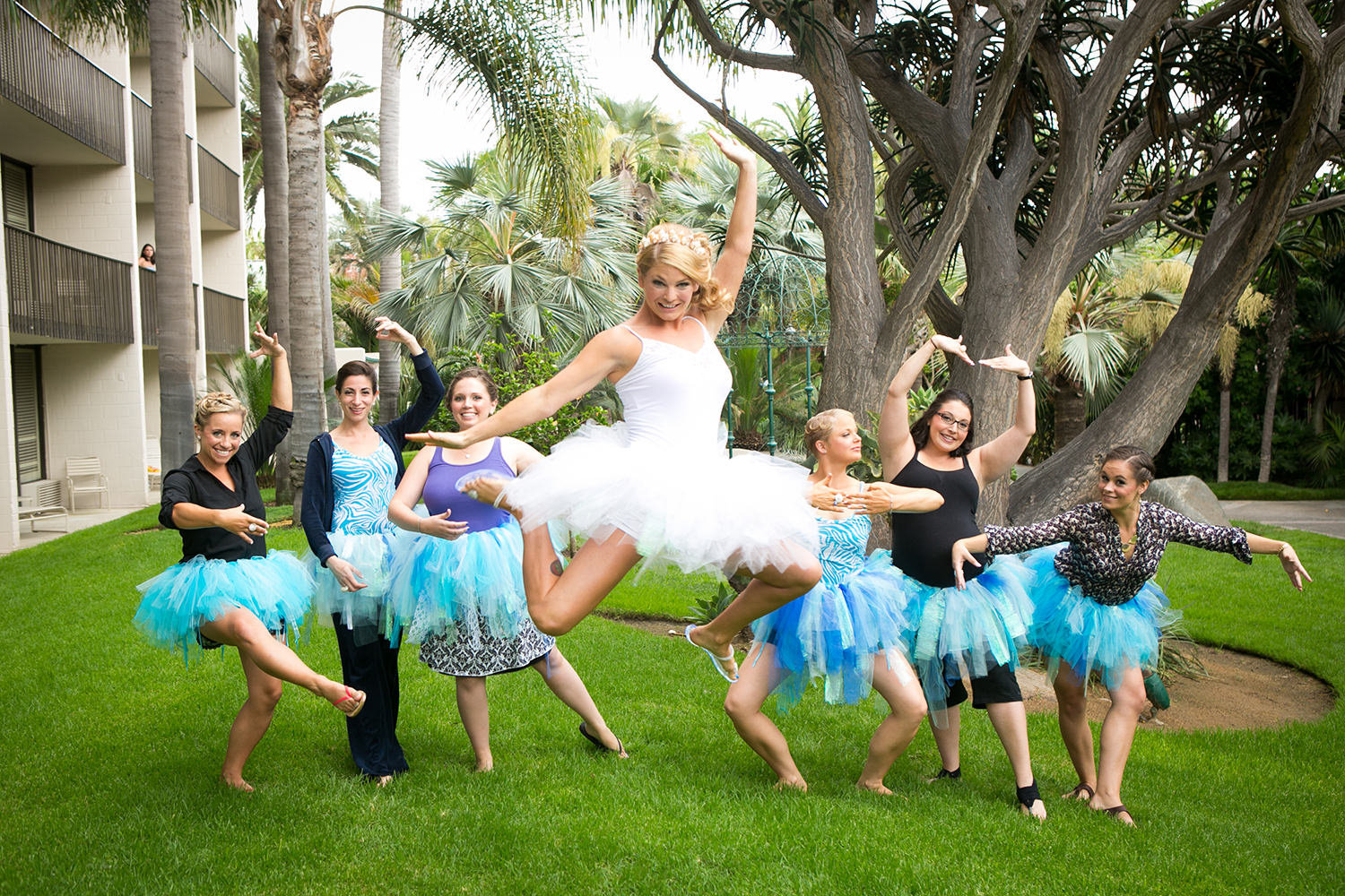 bride and bridesmaids jumping in the air