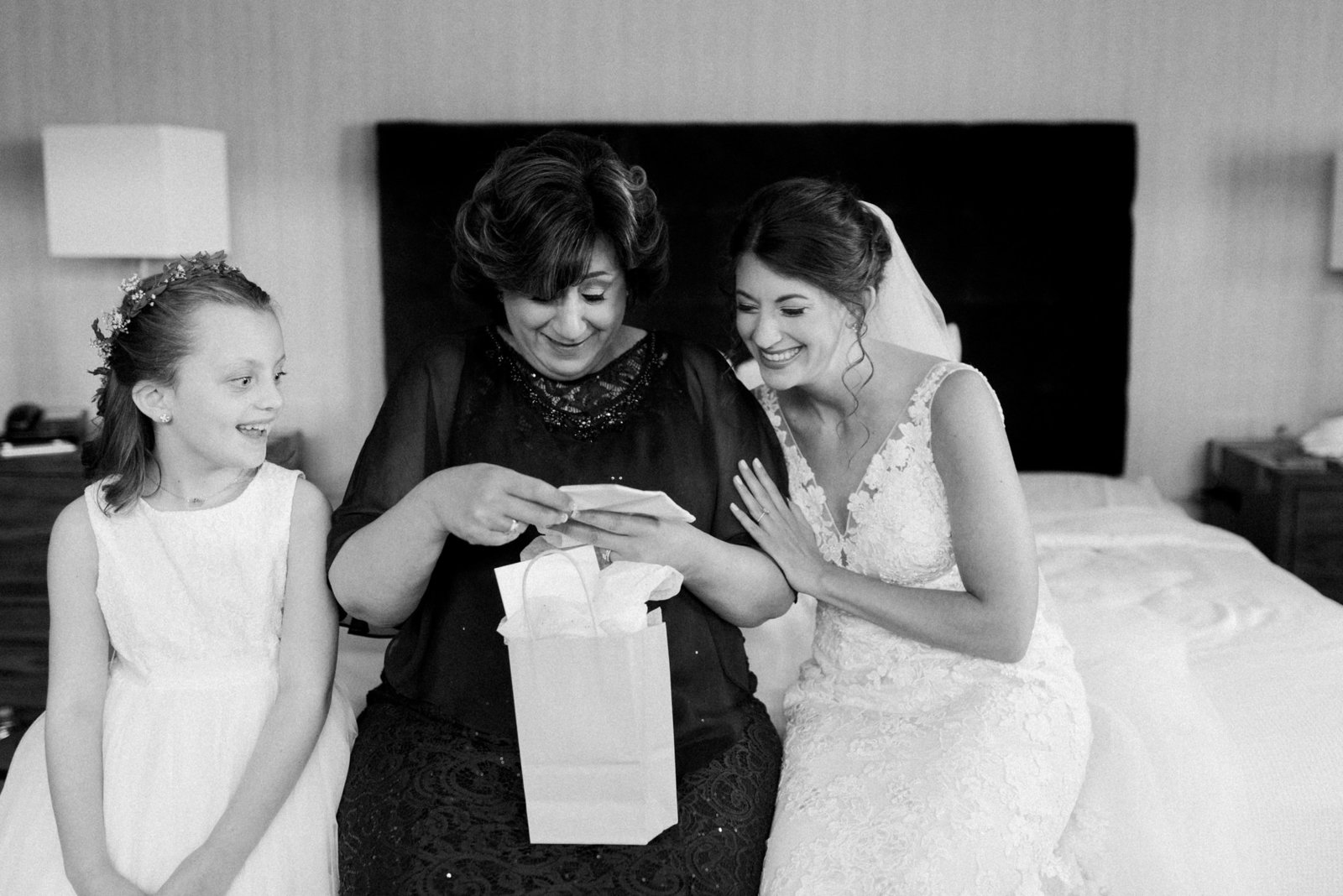 Mother of the bride opening a gift at a Hotel 1620 wedding in downtown plymouth