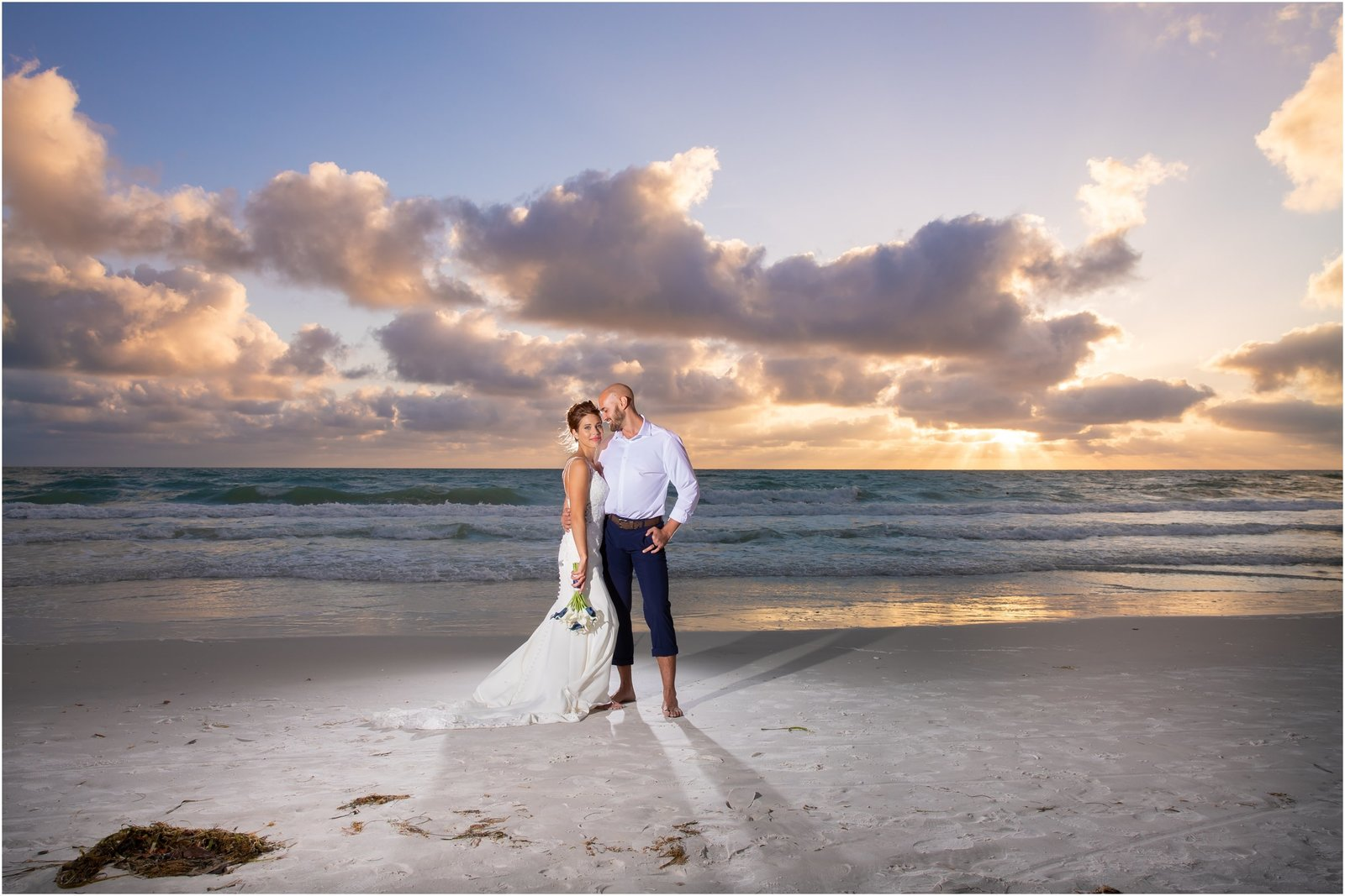 Bride and Groom on Holmes Beach at sunset