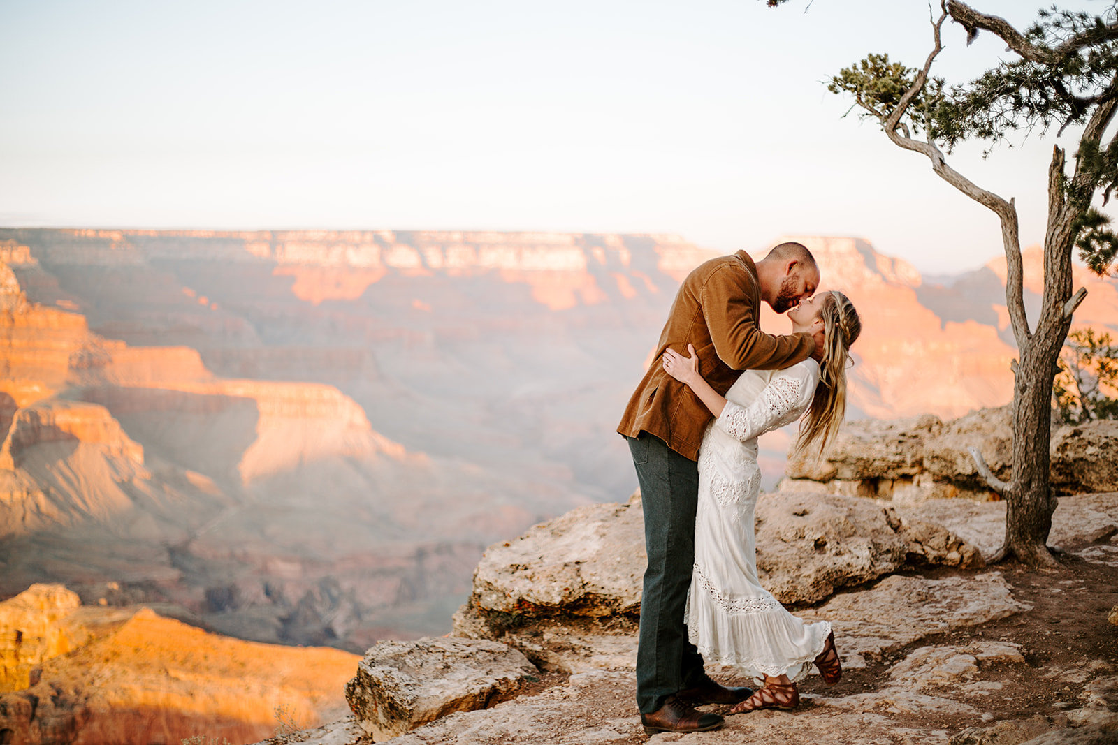Couple kissing and groom dipping his wife back during his Grand Canyon Elopement