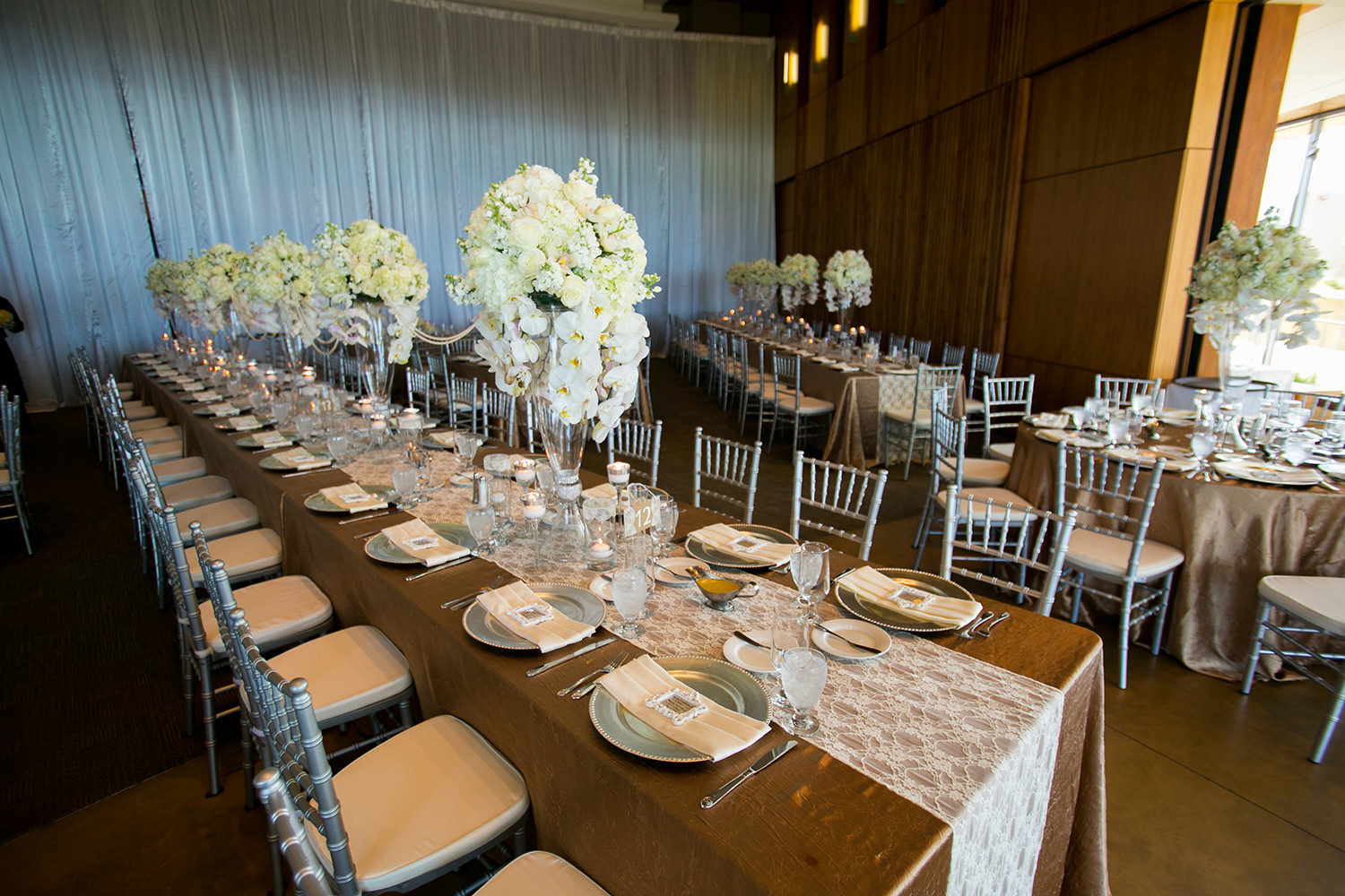 long tables with white flowers