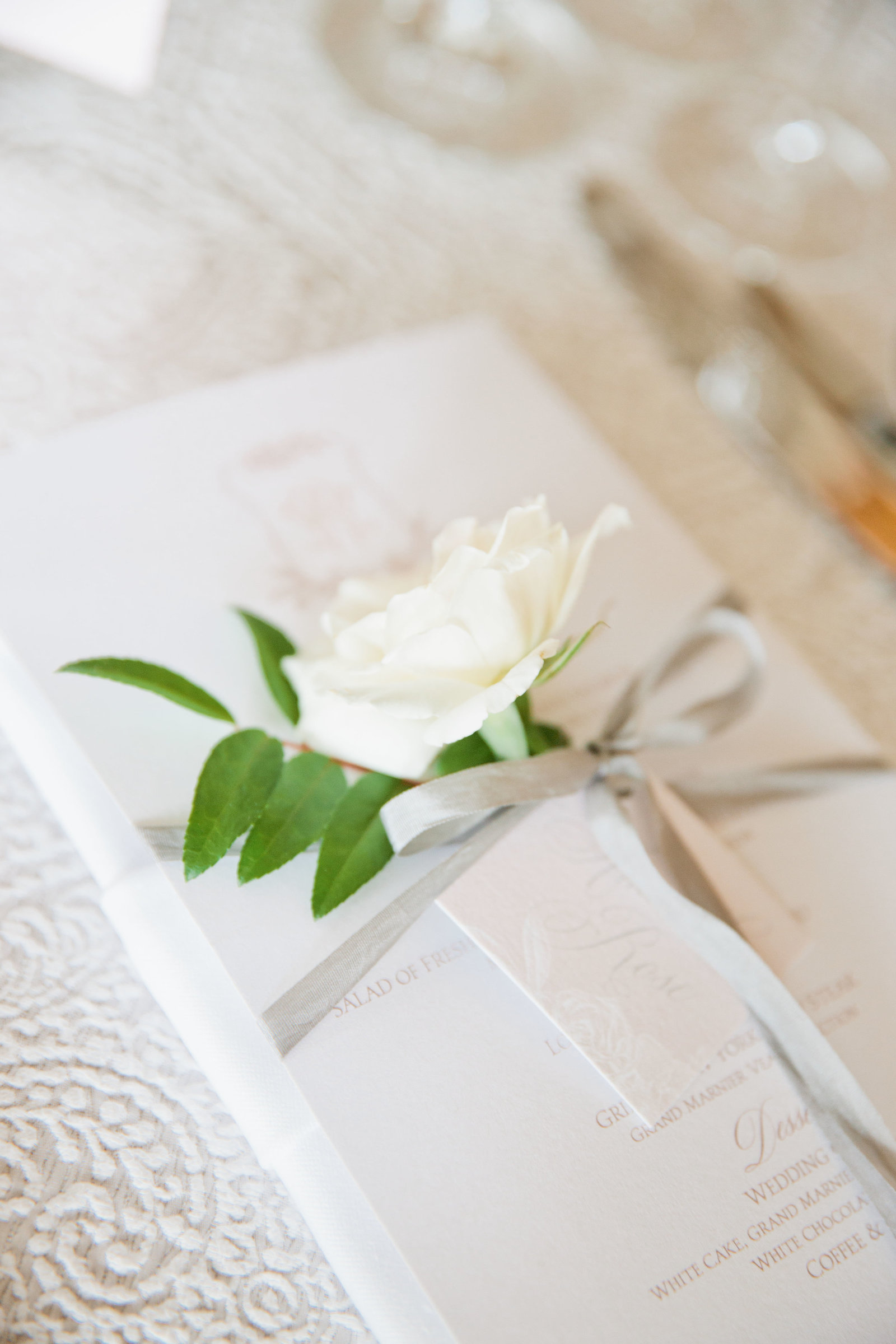Menu cards with hand tags and floral sprigs