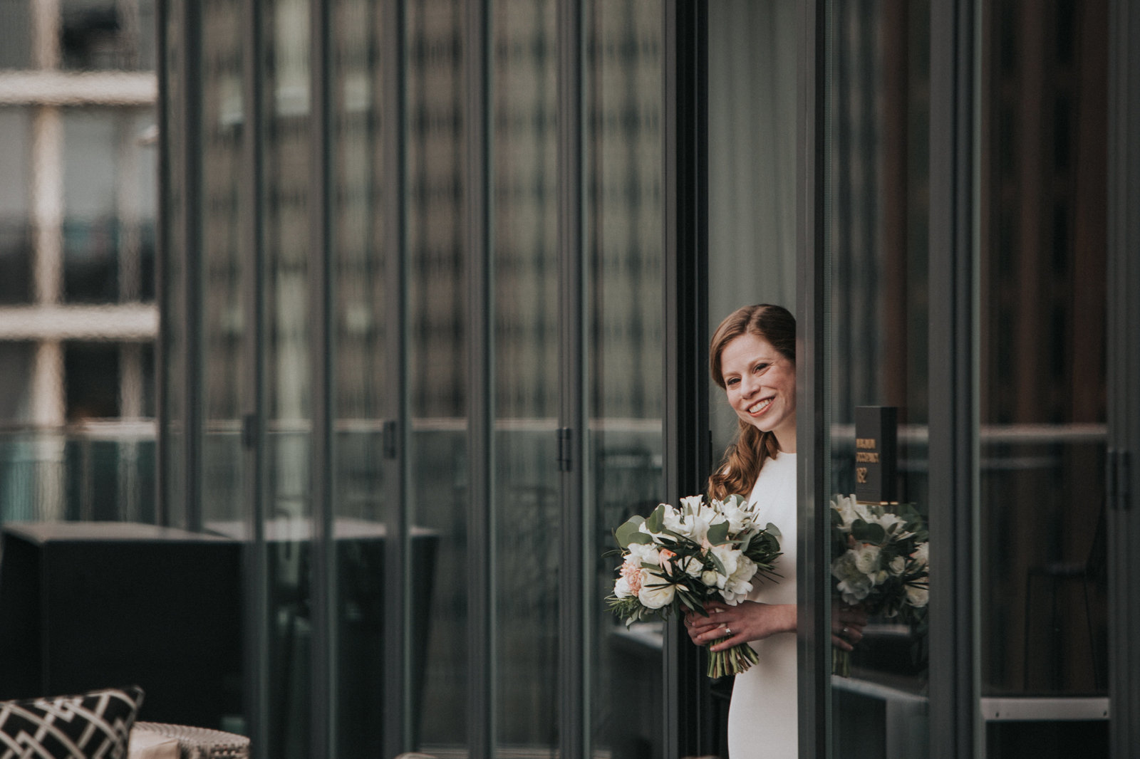 bride on the rooftop at the logan hotel in philadelphia