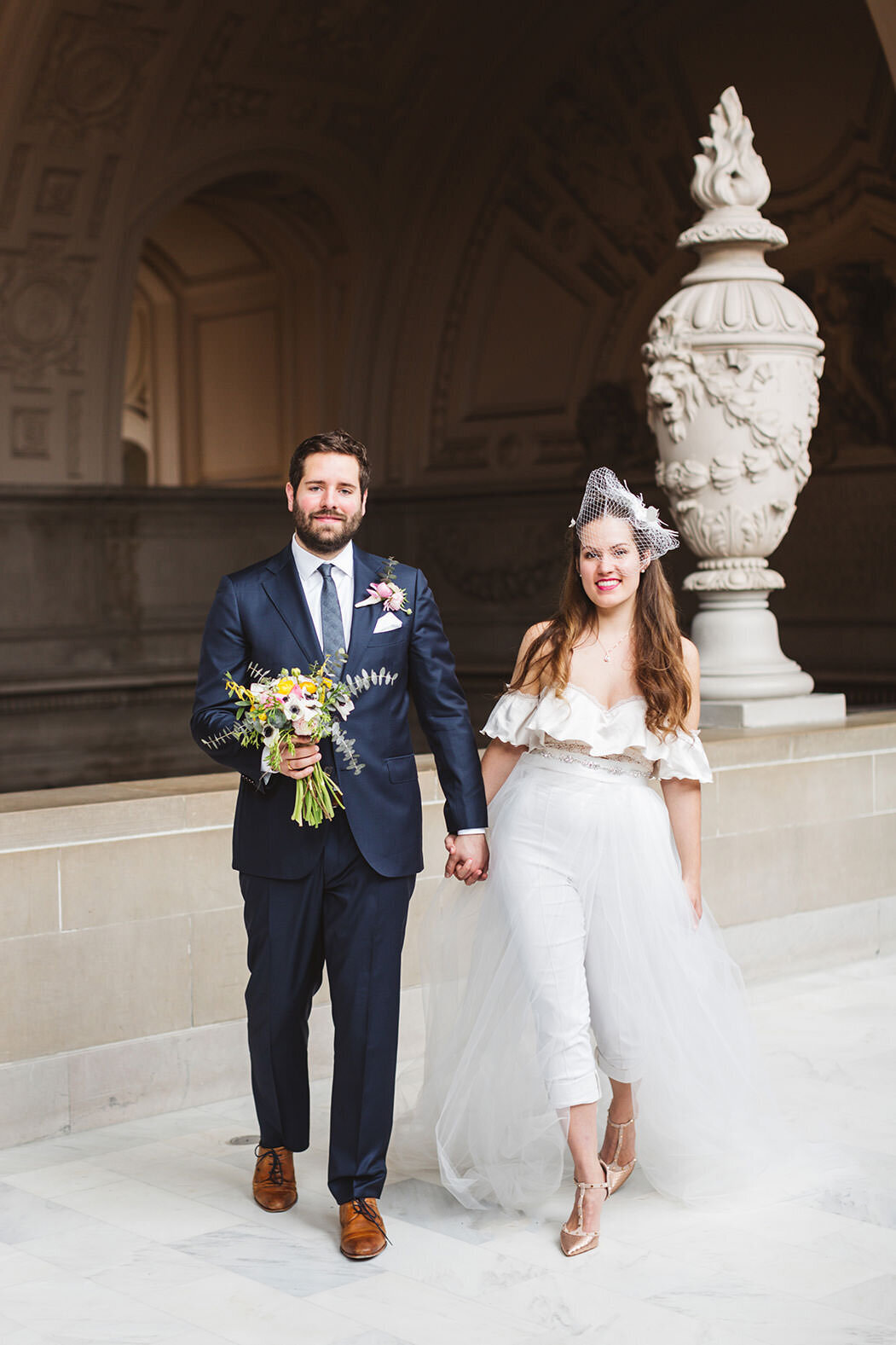 sweet and modern wedding couple with bride in jumpsuit - sf city hall