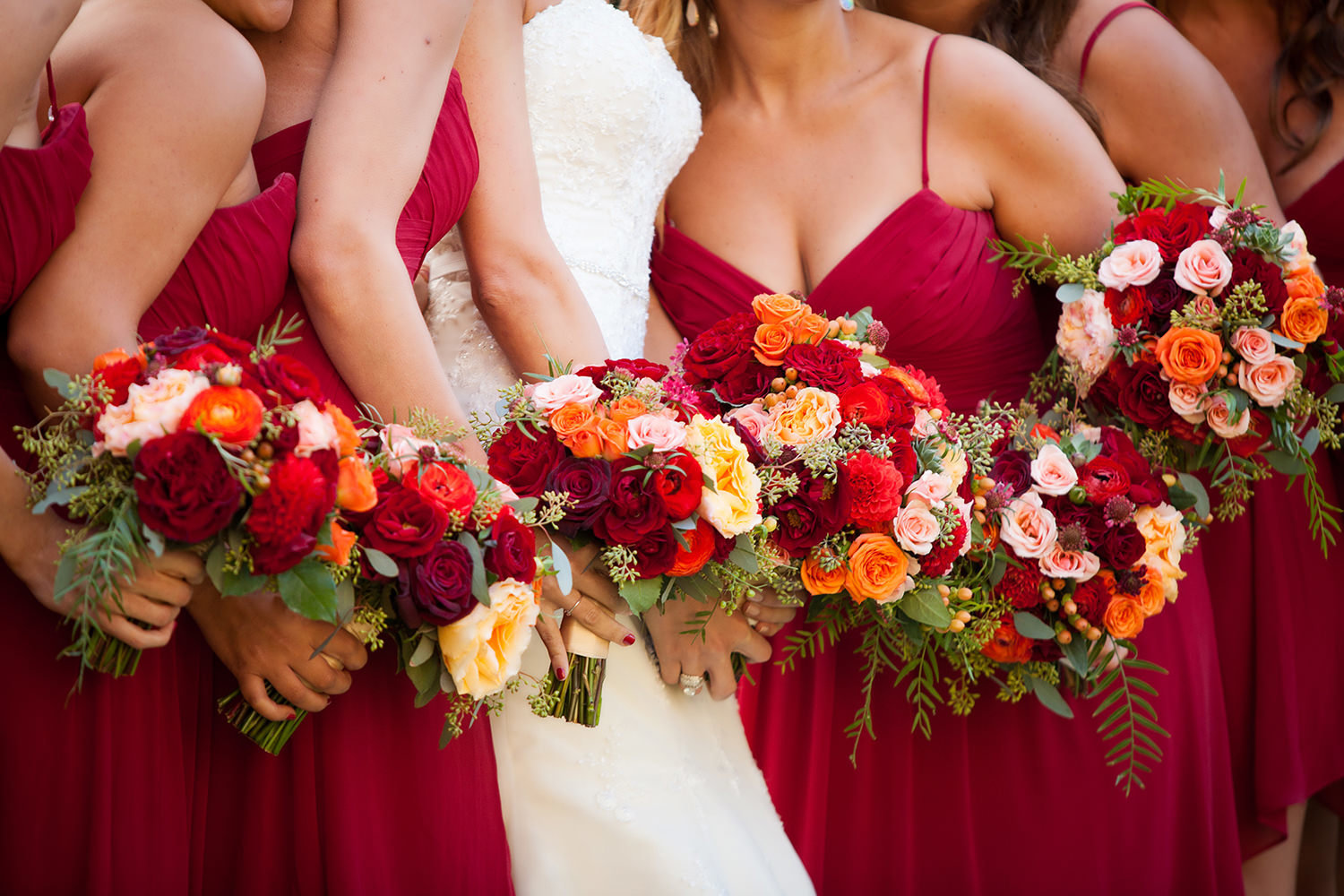 Brightly colored wedding bouquets and dresses