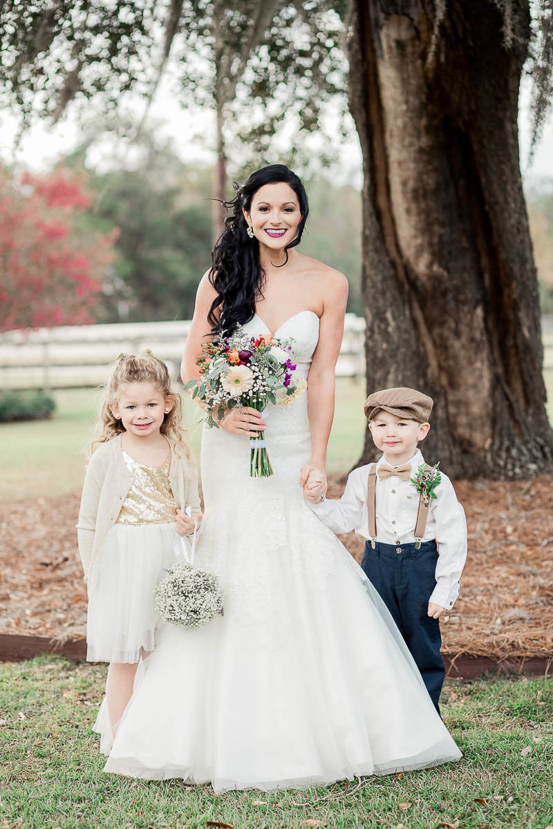 Bride poses with ring bearer and flower girl, Boals Farm, Charleston Wedding Photographer.