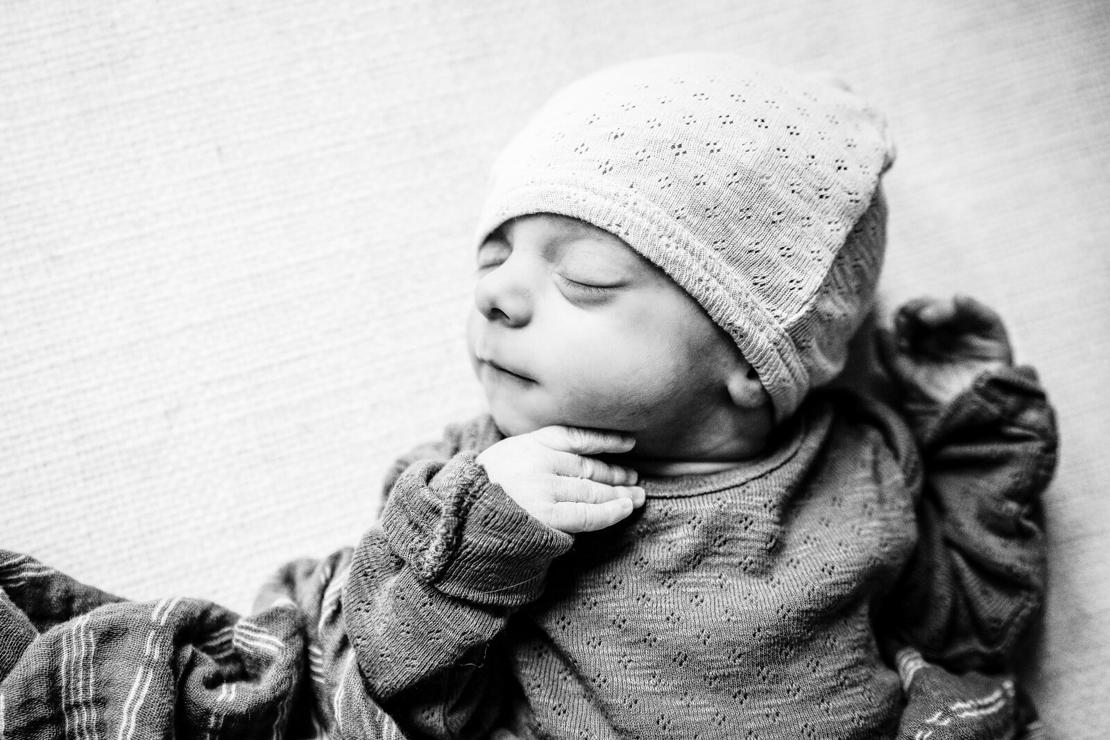 black and white image of newborn baby boy sleeping in boston photography shoot