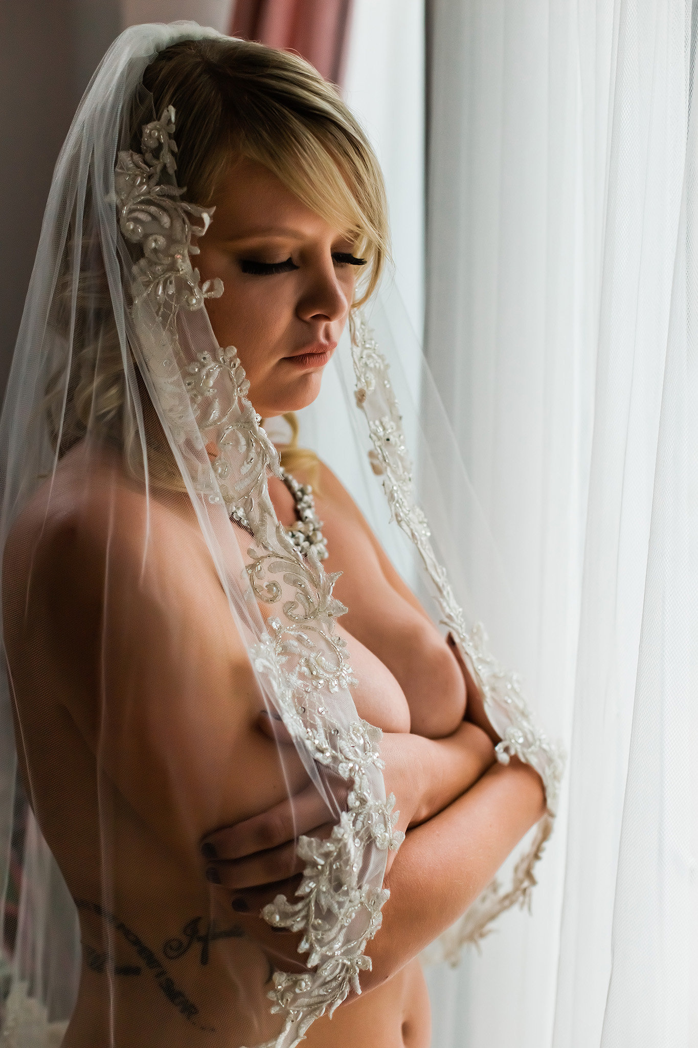 Beautiful bride taking boudoir photos