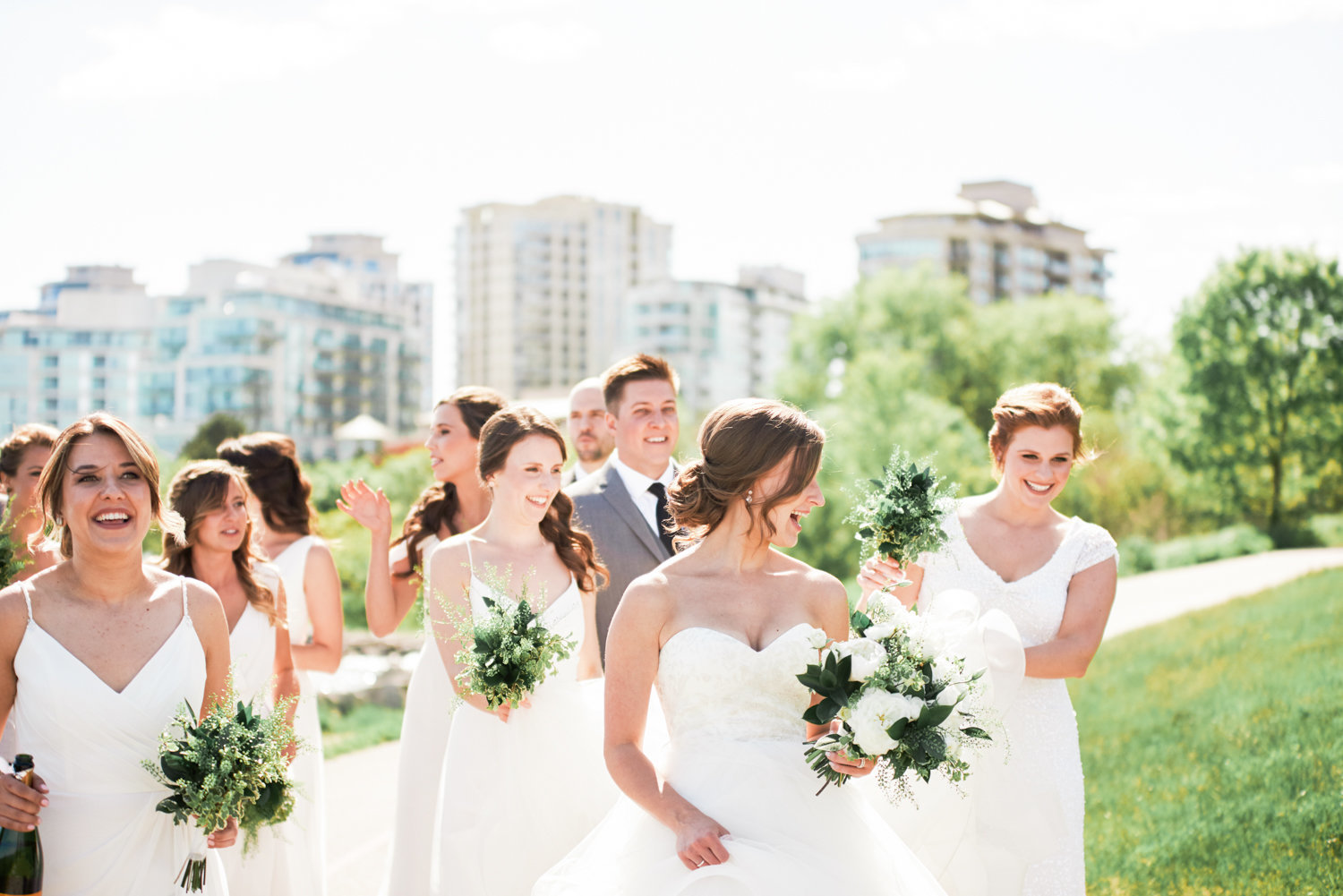Bride and bridesmaids all in white dresses