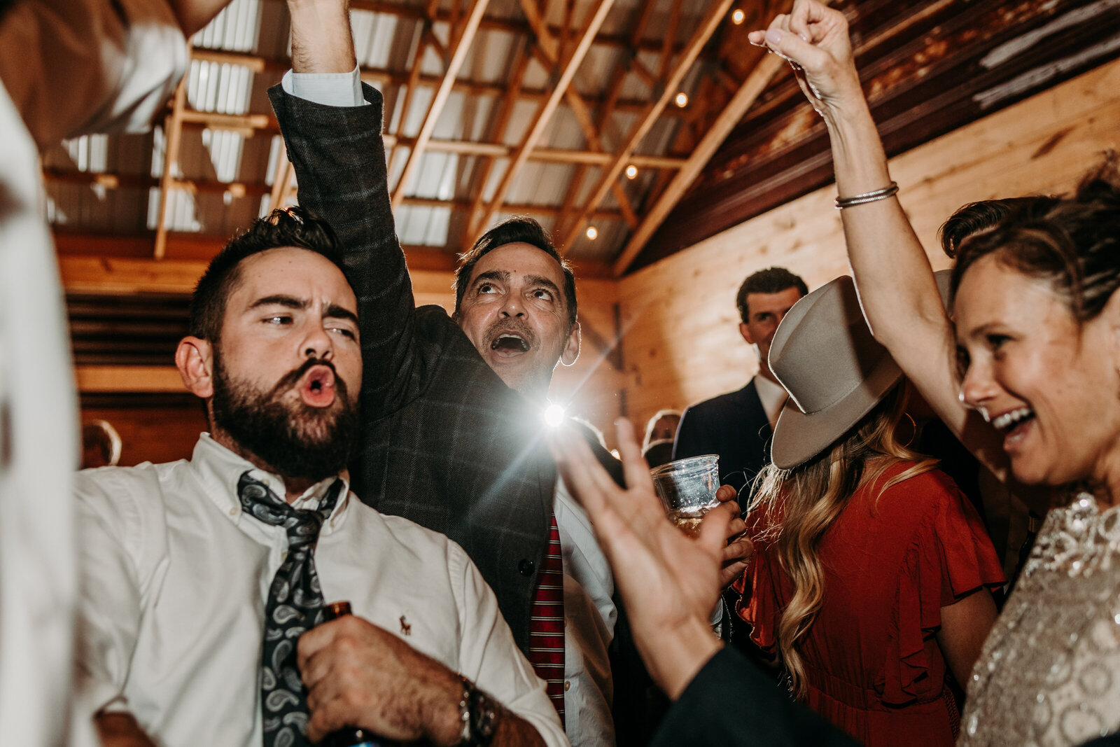 J.Michelle Photography photographs guests dance at a reception at vintage oaks farm wedding in Athens, Ga
