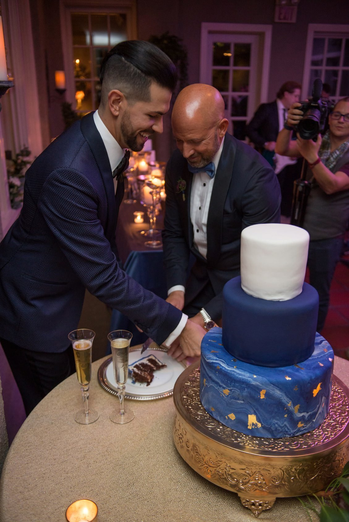 Brendan & Ryan cut their gorgeous wedding cake during their wedding at Lord Thompson Manor