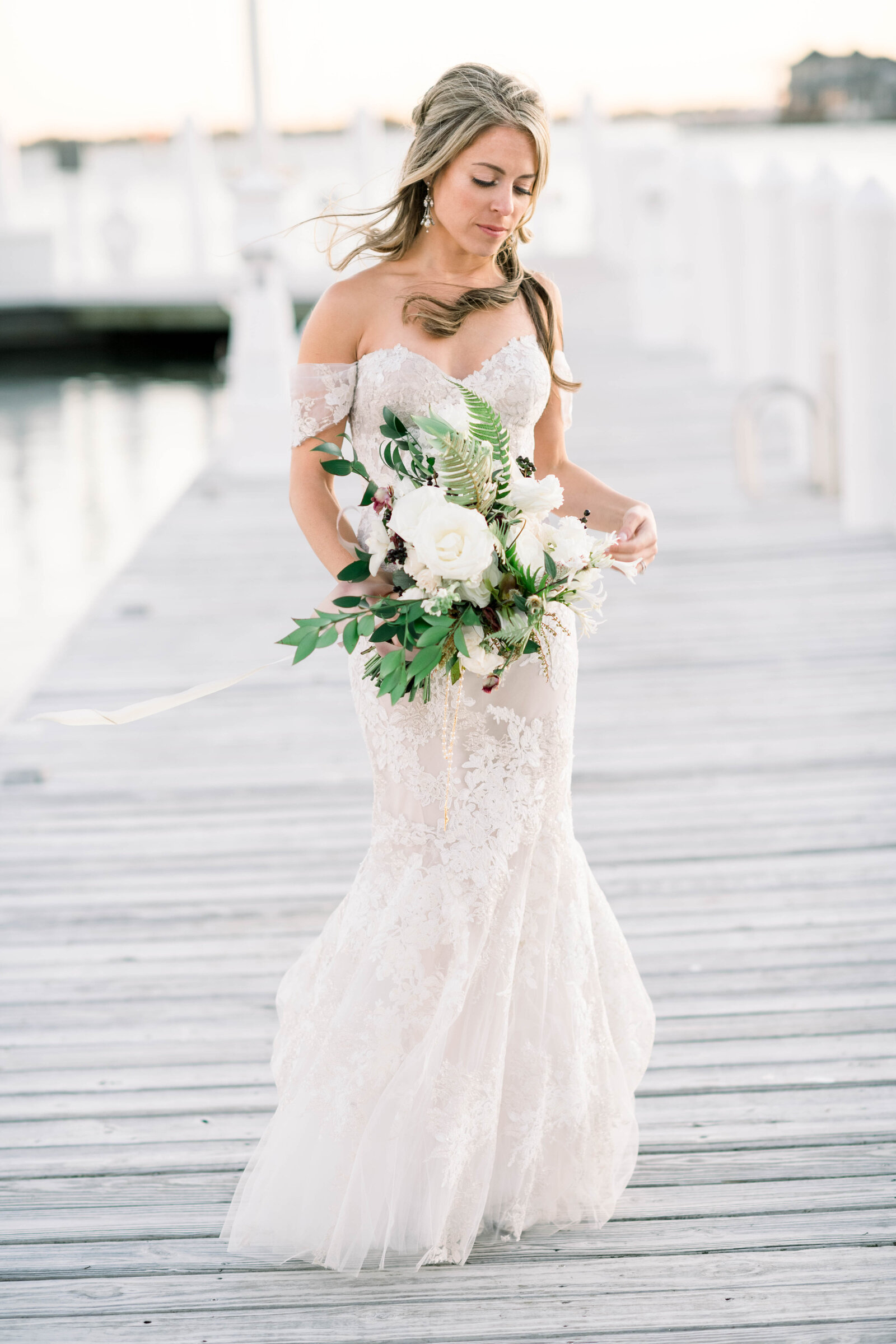 Fine art elegant refined wedding on the water with Monique Lhuillier wedding gown black tie and organic florals in Bay Head New Jersey by Liz Andolina Photography