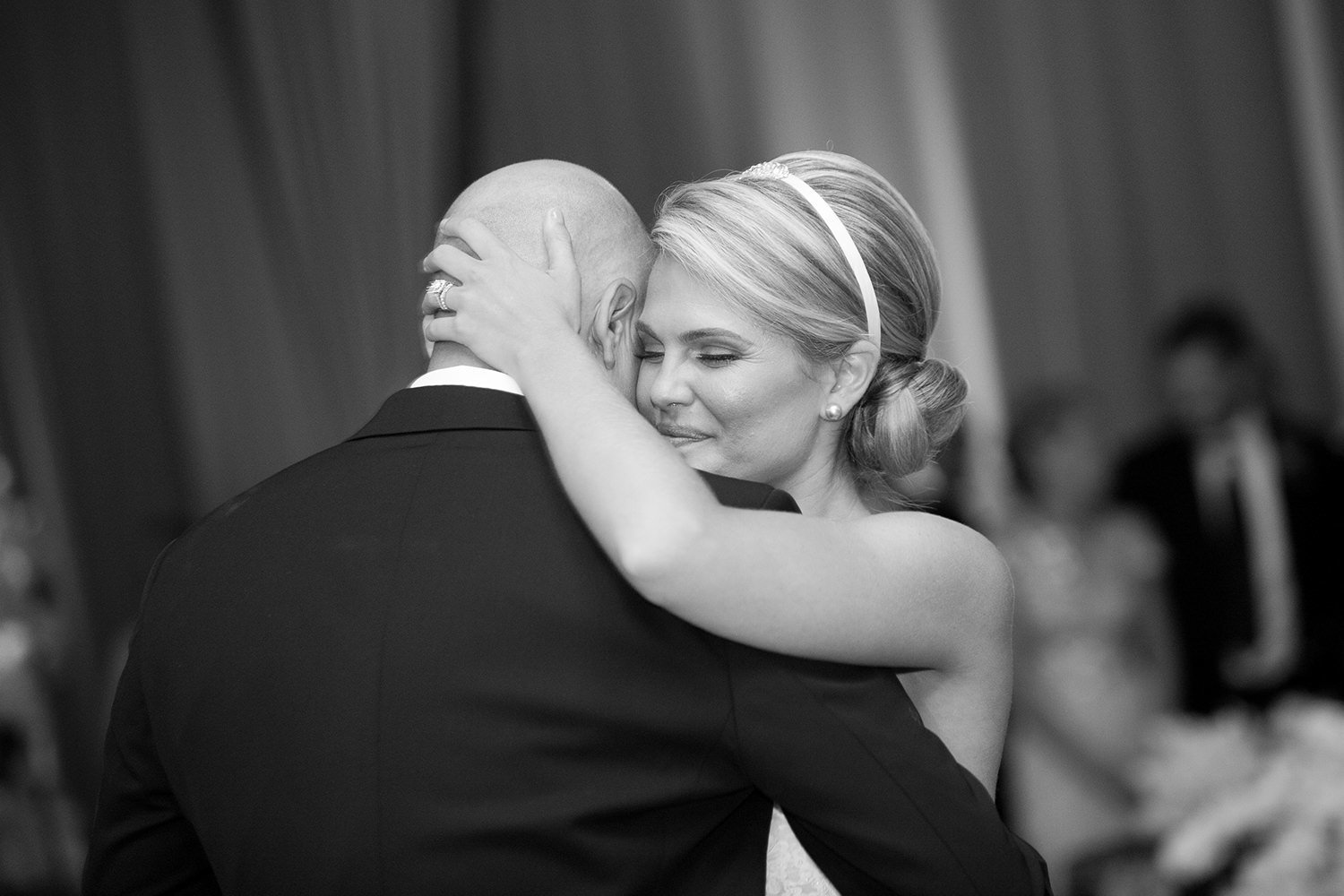 Emotional moment between the bride and her father during the father daughter dance