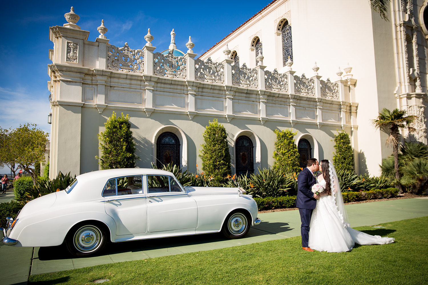 bride and groom at the immaculata with a classic car