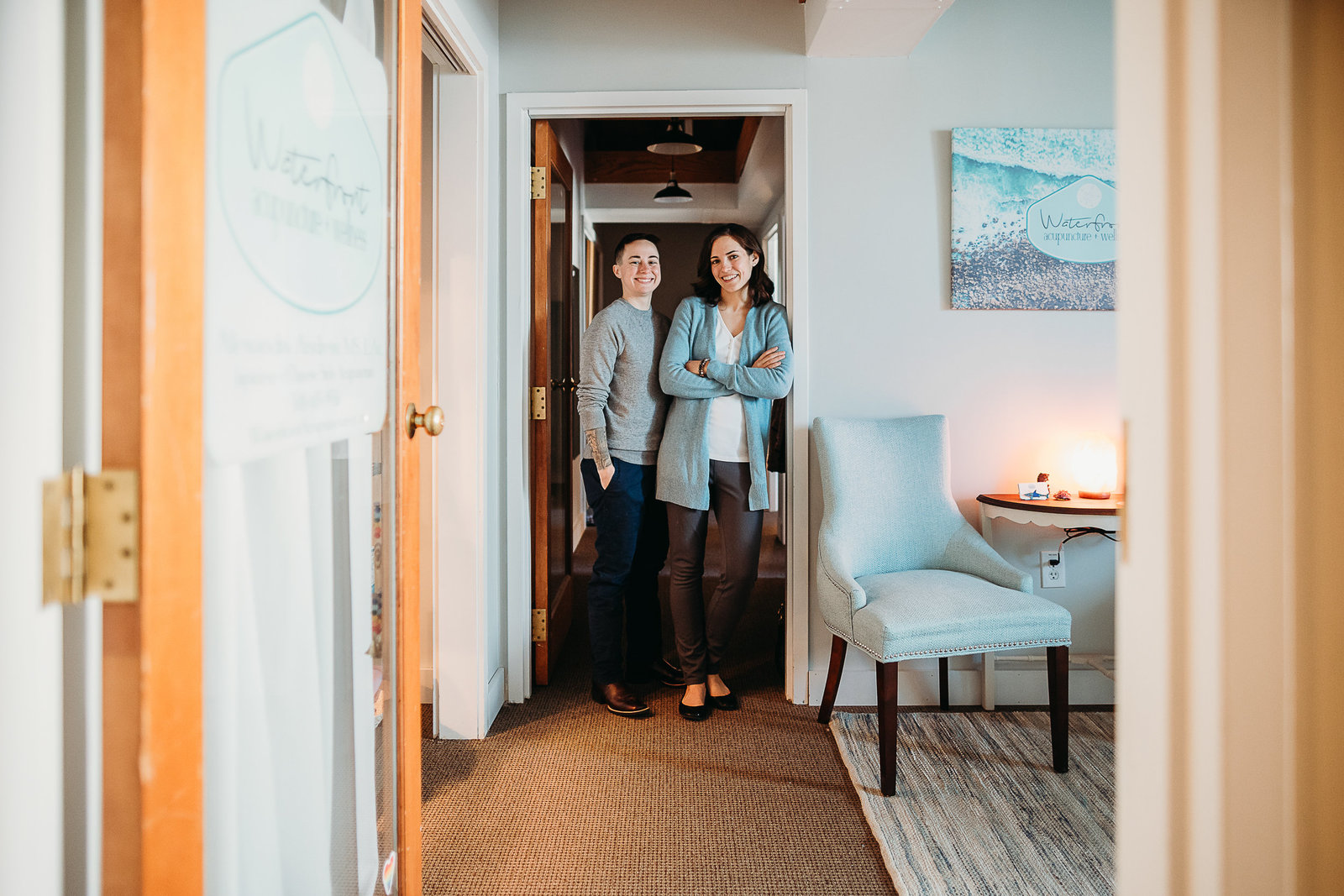 two women stand in doorway of clinic for branding shoot south shore ma