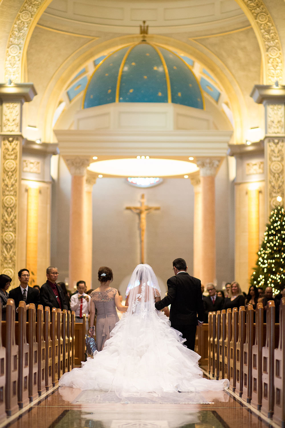 bride with father walking down the aisle at the immaculata