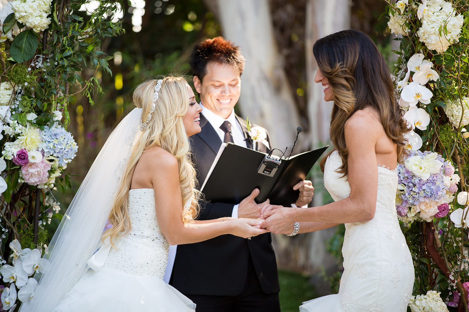 Two brides say their vows at a colorful wedding ceremony