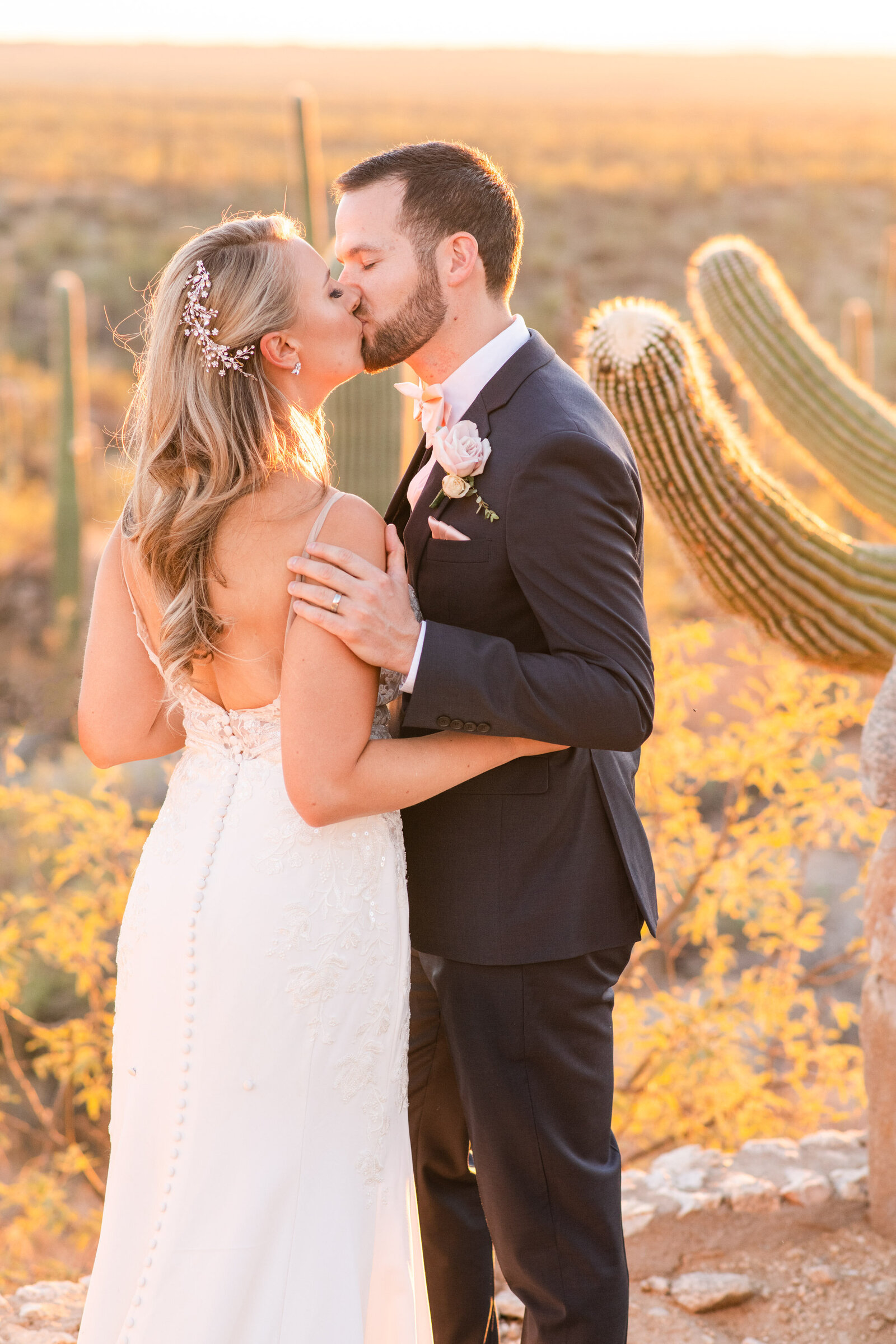 bride and groom portrait at sunset on Tanque Verde Ranch house
