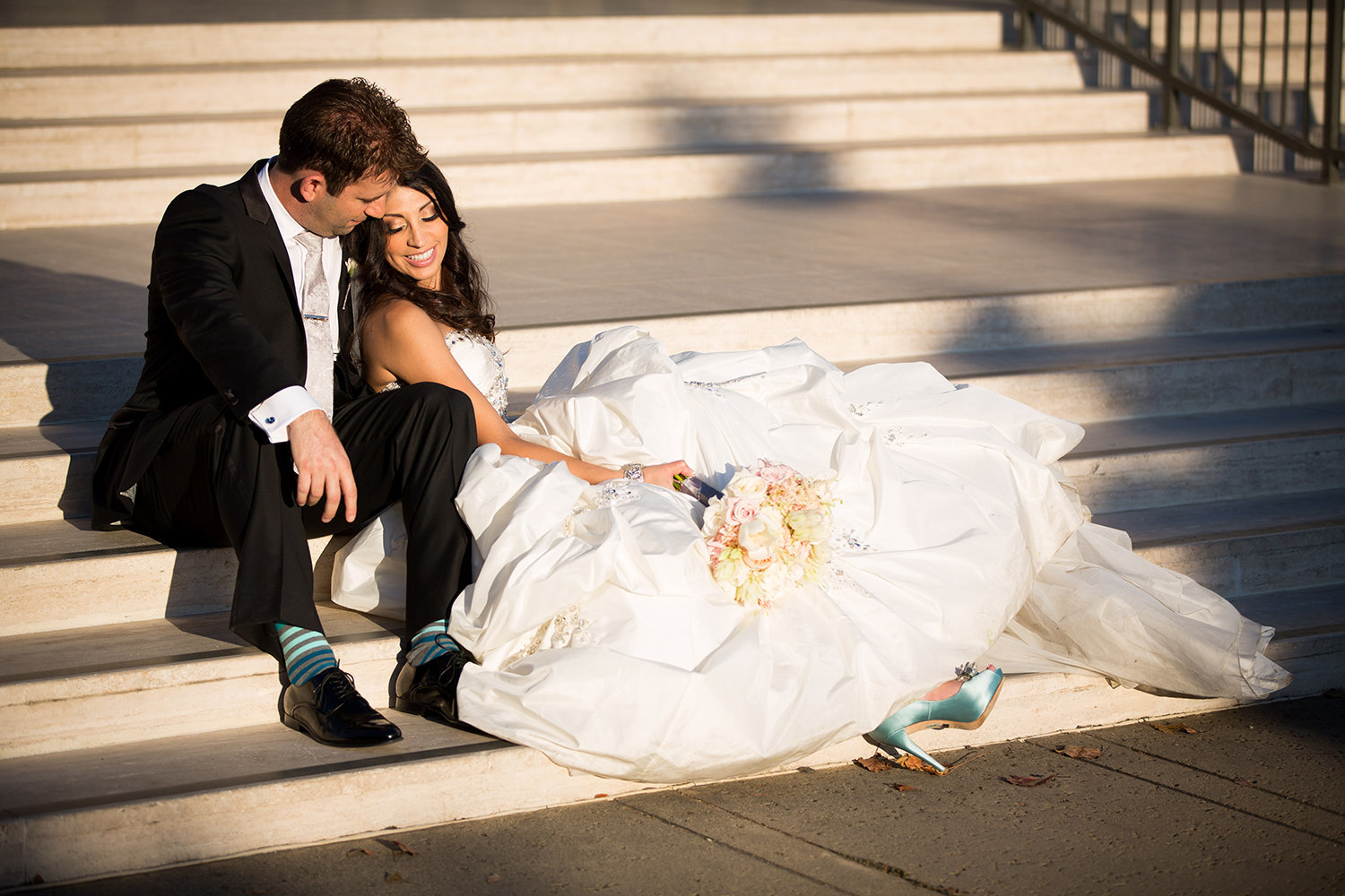 Romantic posing idea for bride and groom with stairs